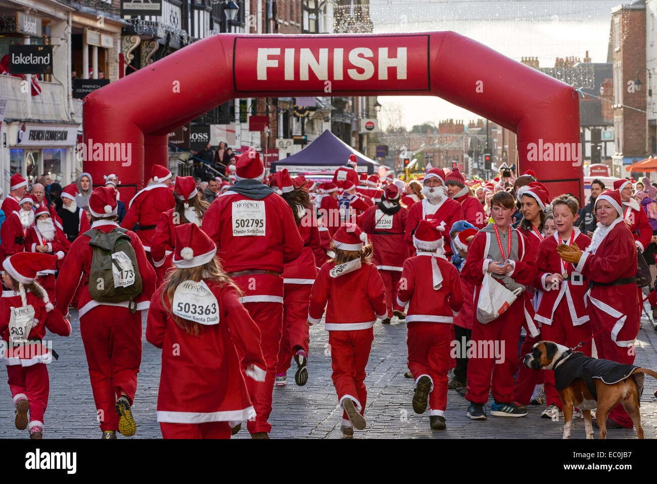 Chester, UK. 7th Dec, 2014. Competitors take part in the 2014 charity Santa Dash through the streets of Chester - Stock Image