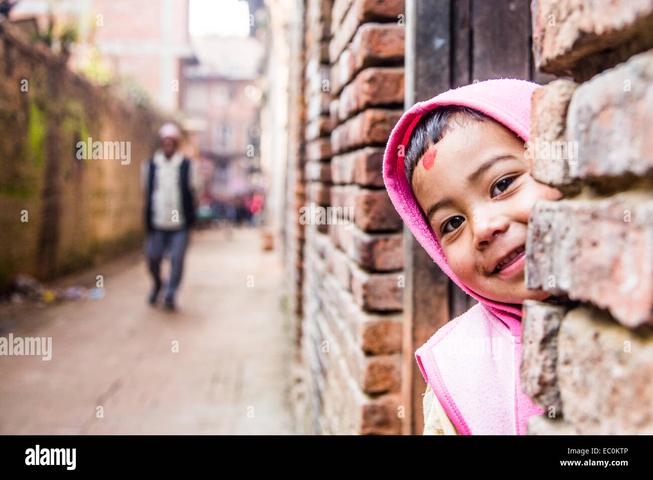 Young Napali boy in a doorway in Bhaktapur, Nepal - Stock Image