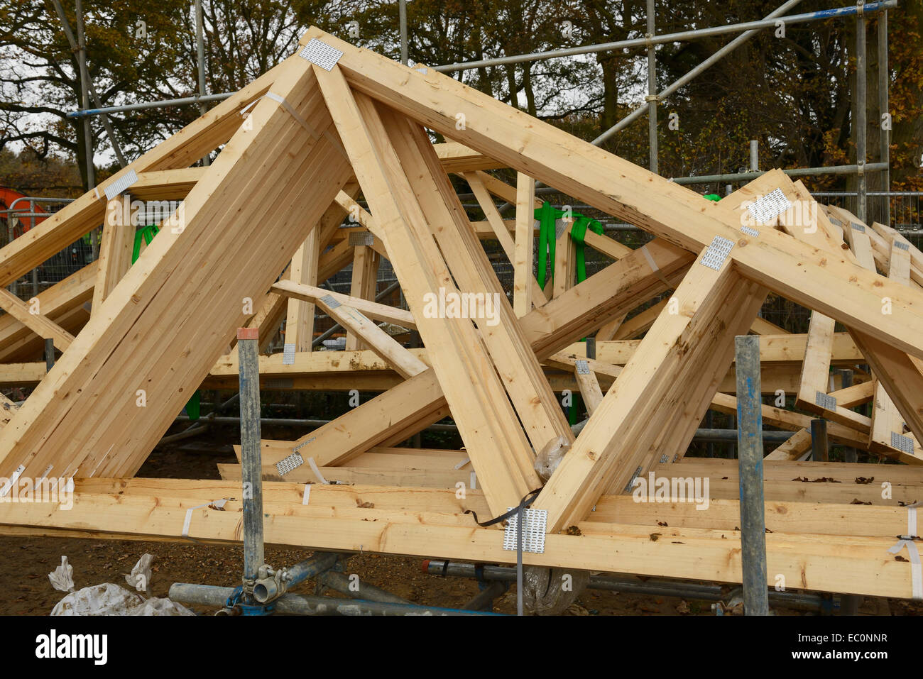 Wooden roof trusses on a uk construction site stock photo for Buy roof trusses online