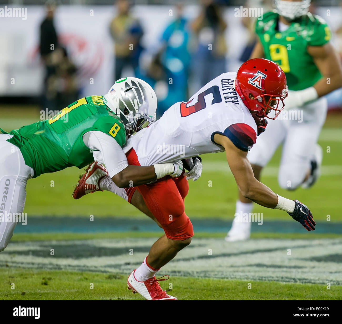 4d690f8d4 December 4, 2014: Arizona Wildcats running back Trey Griffey (5) is tackled