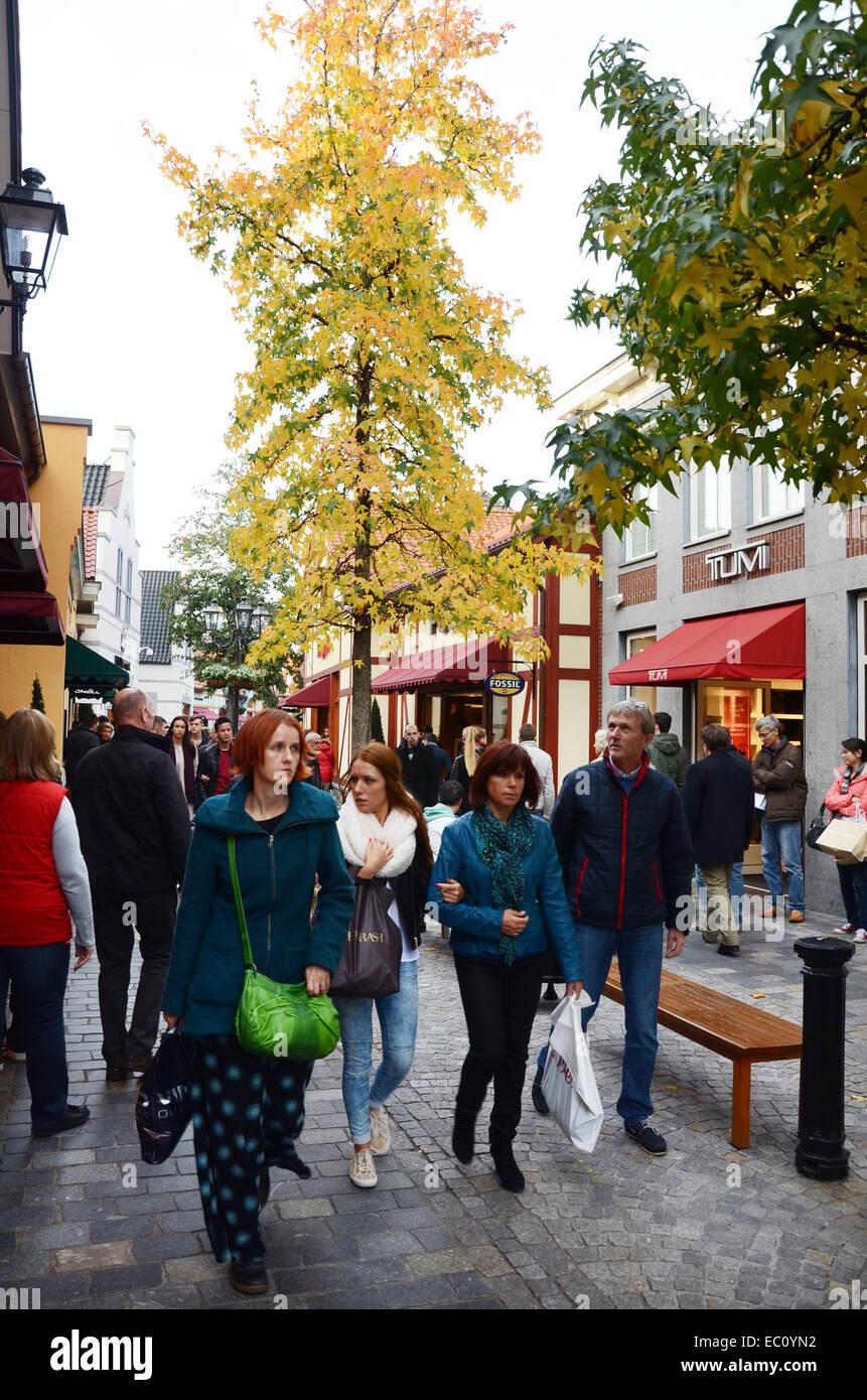 Shopping at McArthur Glen DOC, Roermond Netherlands - Stock Image