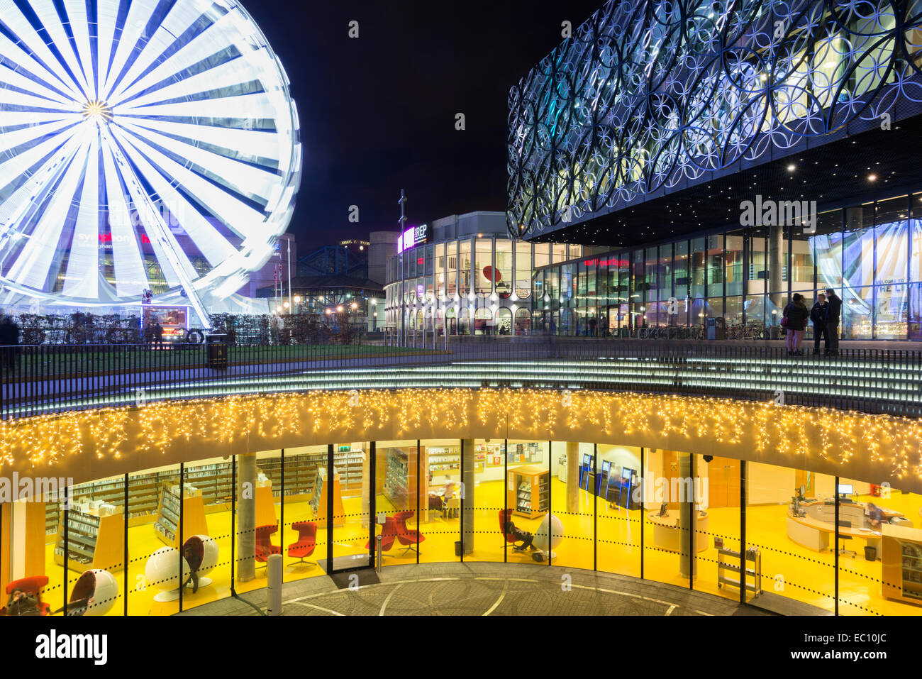 The library of Birmingham in Centenary Square, Birmingham, England, and ferris wheel. - Stock Image
