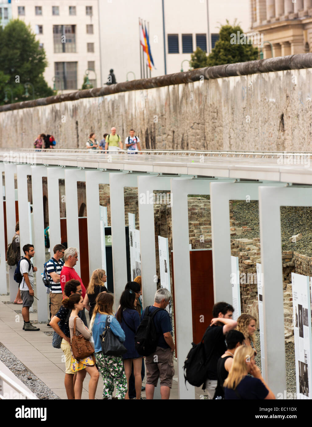 Visitors read the information available at Berlin's Topography of Terror Museum. - Stock Image