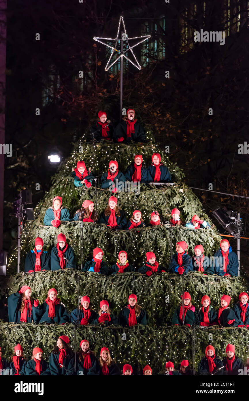 Schoolchildren of Zurich perform Christmas songs as 'singing Christmas tree' in Zurich city - Stock Image