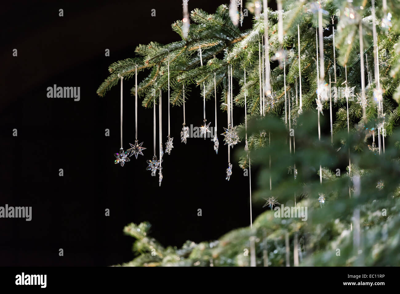 Swarovski jewelery is hanging off a Christmas tree at the Christmas market that is held inside the hall of Zurich - Stock Image
