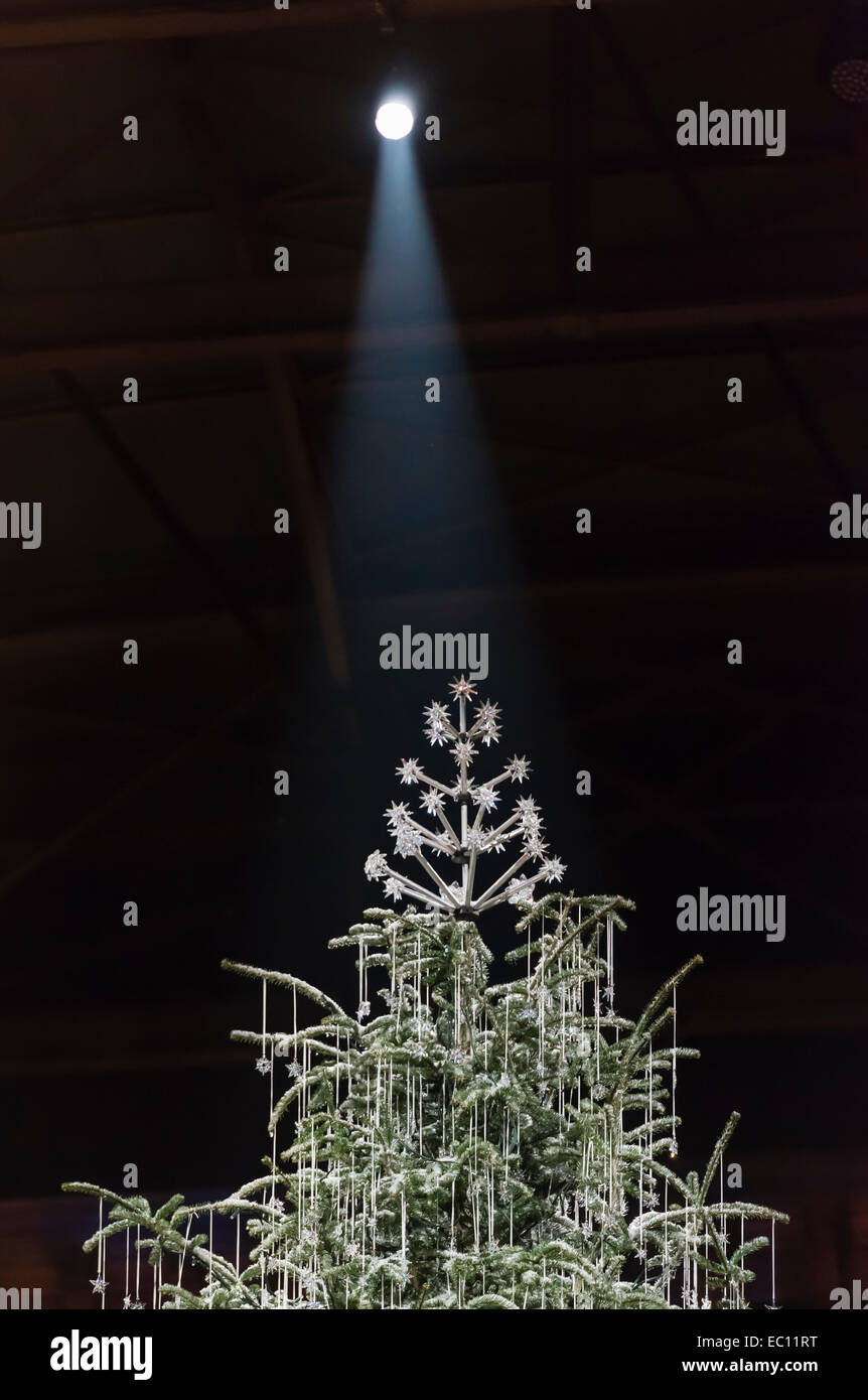 A giant christmas tree, draped with Swarovski jewelery, main attraction of Zurich's christmas market inside - Stock Image