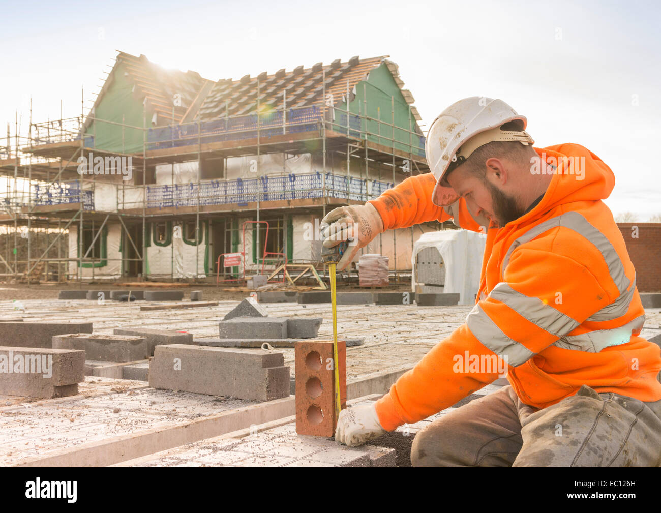 A builder working on a building site - Stock Image