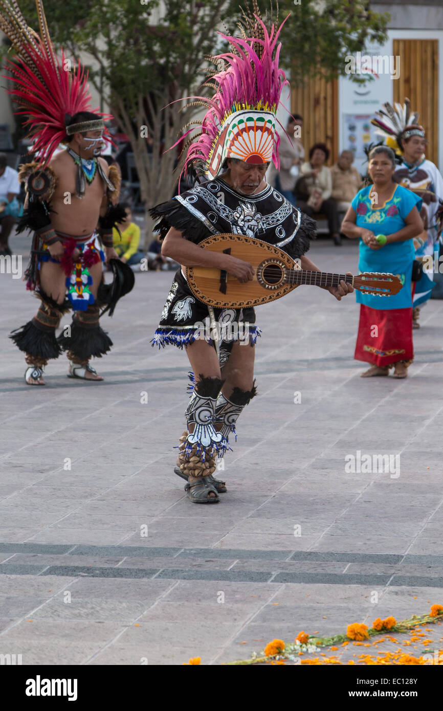 Concheros dancers performing a traditional dance and ceremony on dia de los muertos in Queretaro, Mexico. - Stock Image