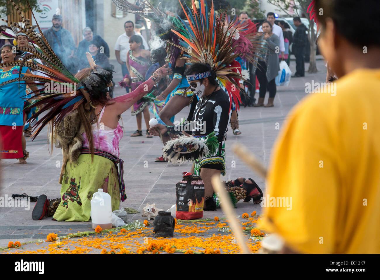 Concheros dancers performing a traditional dance and ceremony on dia de los muertos in Queretaro, Mexico. Stock Photo