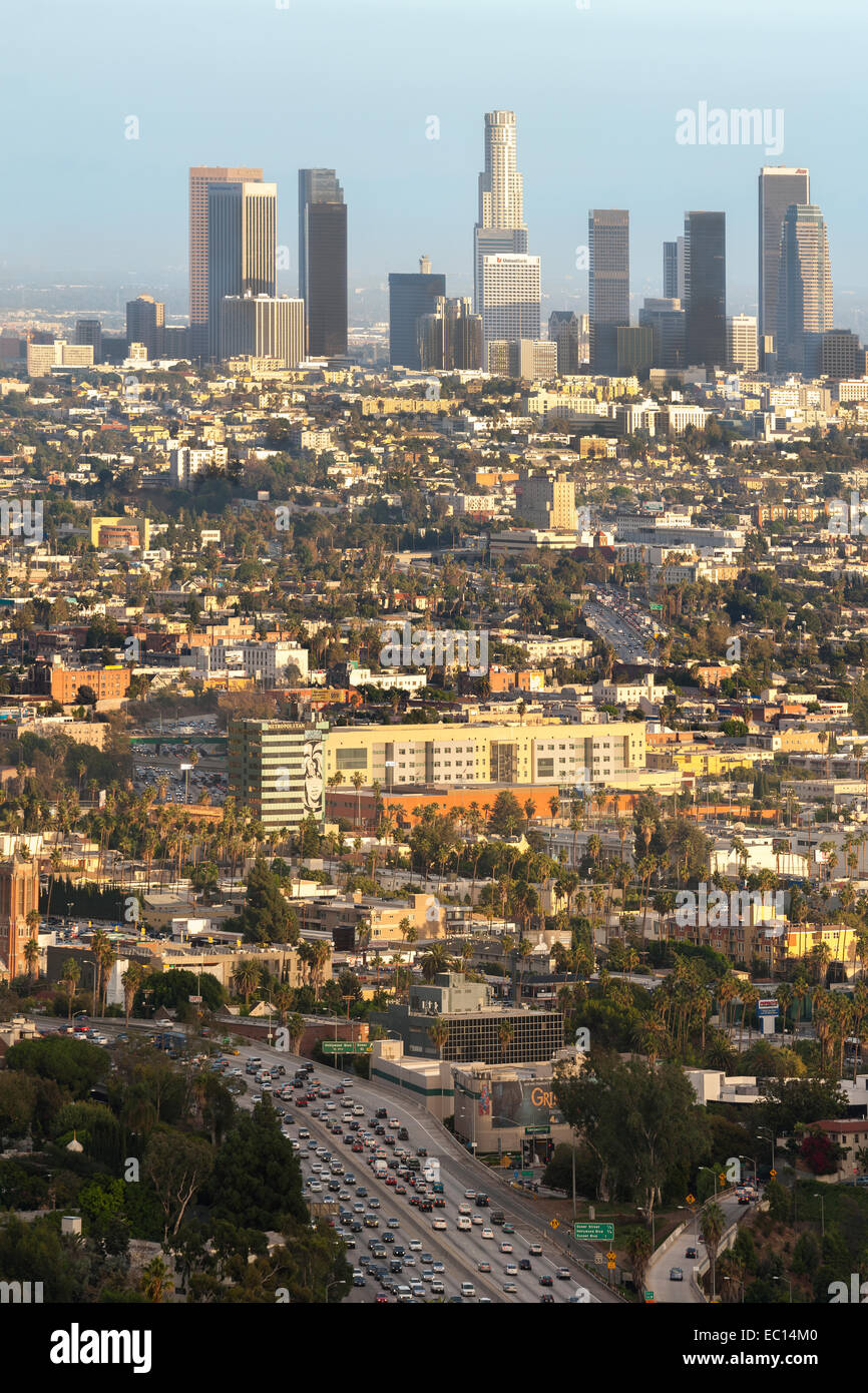 Los Angeles city downtown skyline across Hollywood. Freeway 101 with traffic congestion. View from Mulholland Drive. - Stock Image