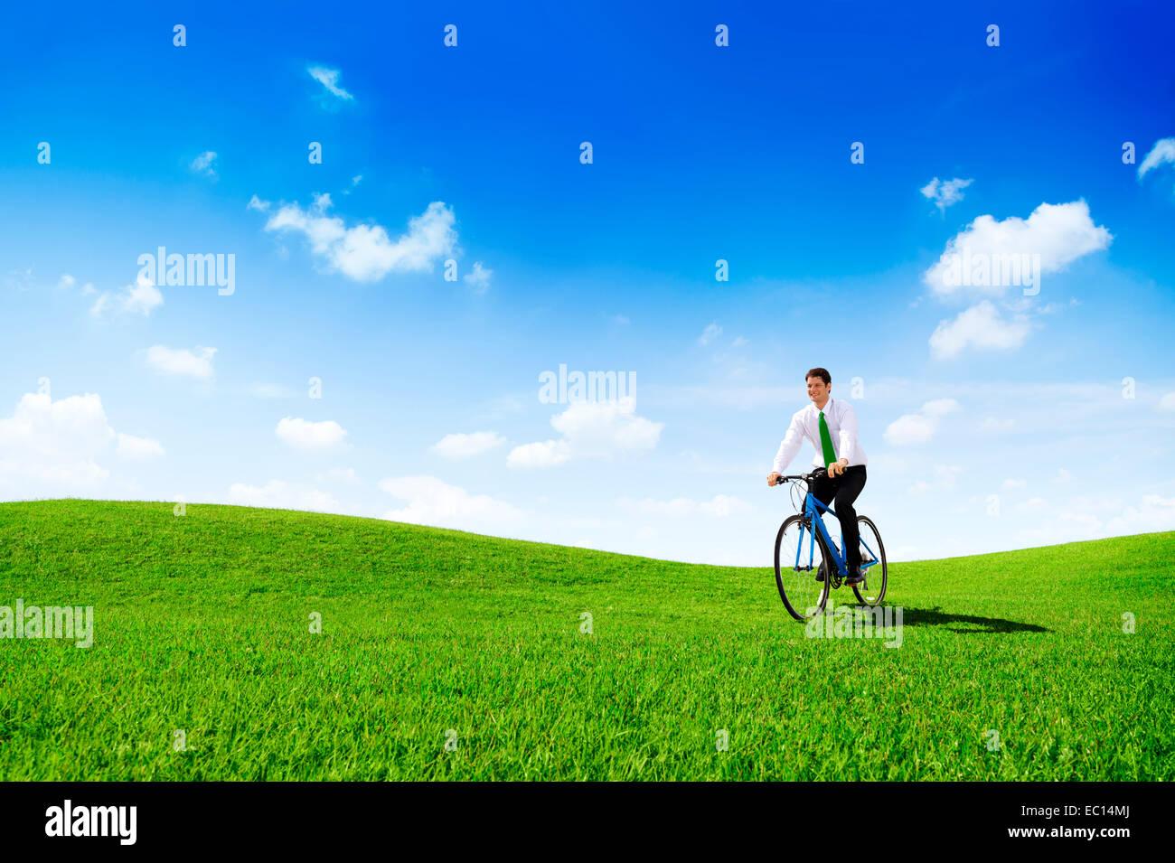 Green Concept Business Man Cycling Bicycle Outdoors - Stock Image