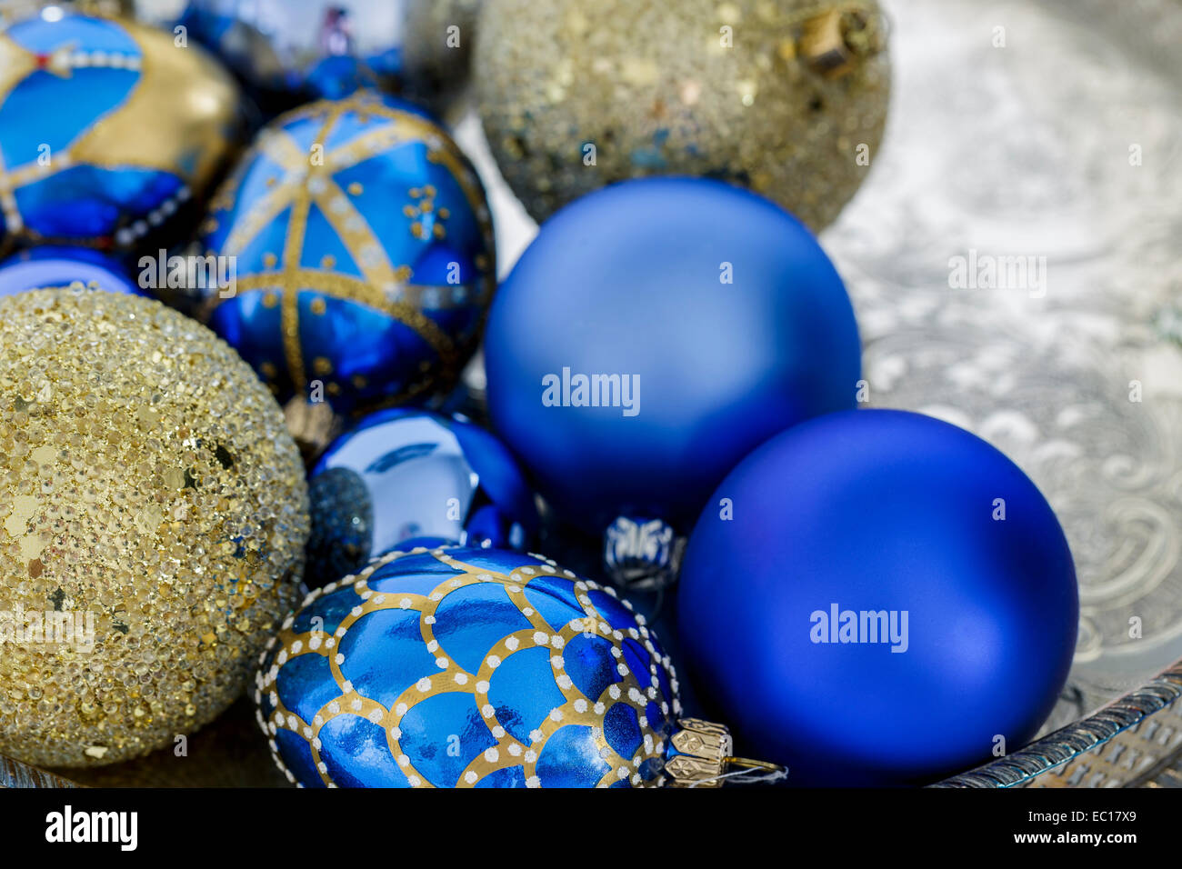 blue and gold christmas decorations on a silver tray stock image