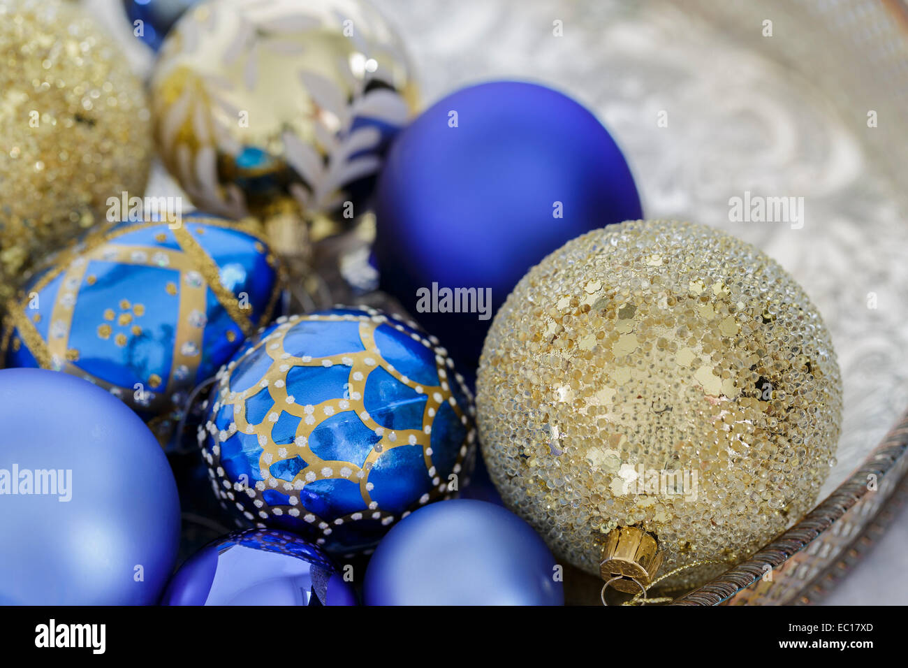 blue and gold christmas decorations on a silver tray stock image - Blue And Gold Christmas Decorations
