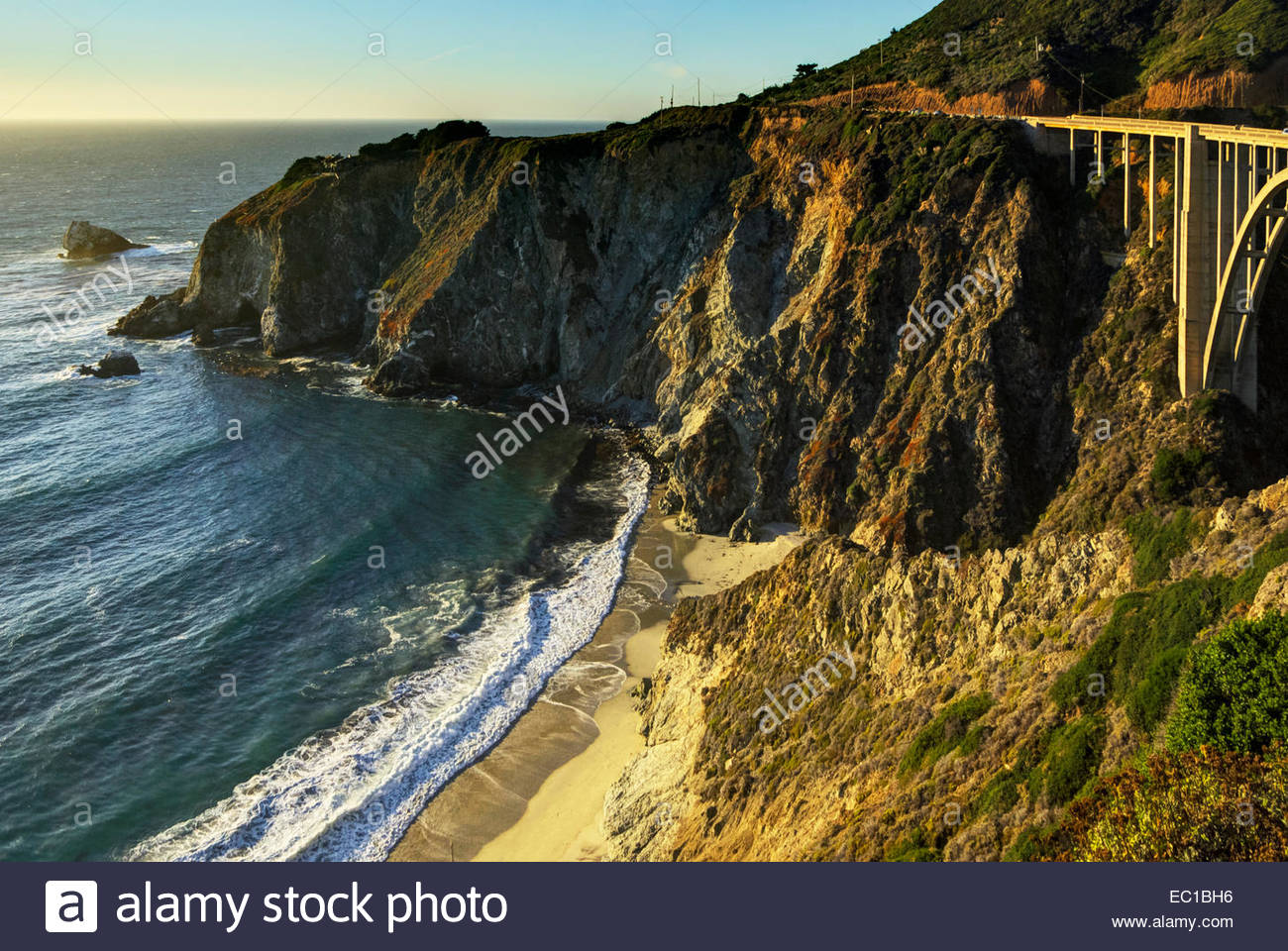 Bixby Bridge is a famous Cabrillo Highway (California One, coast road) landmark nearby house perched dramatically - Stock Image