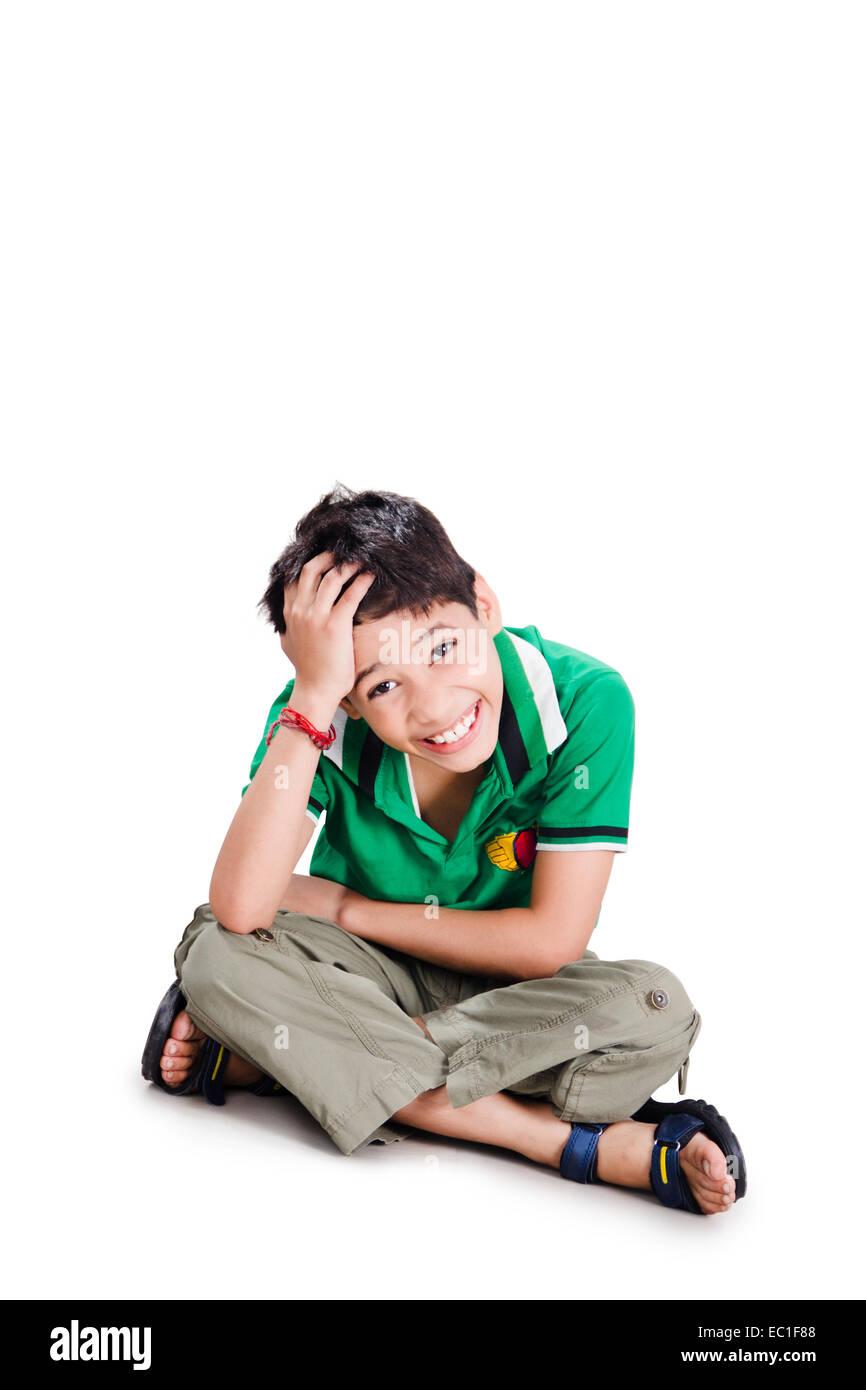 1 indian child boy sitting - Stock Image