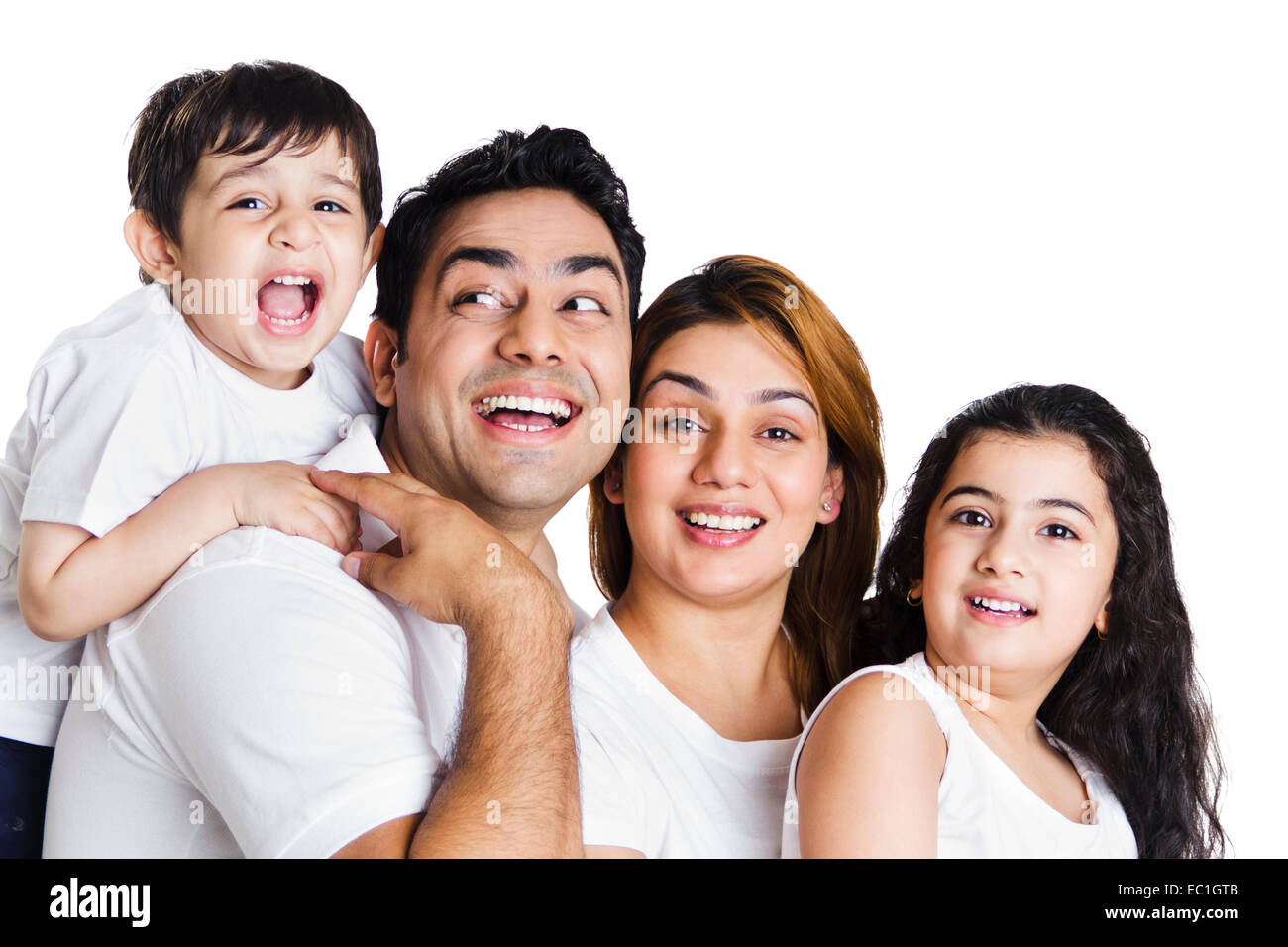 indian Parents with  children fun - Stock Image