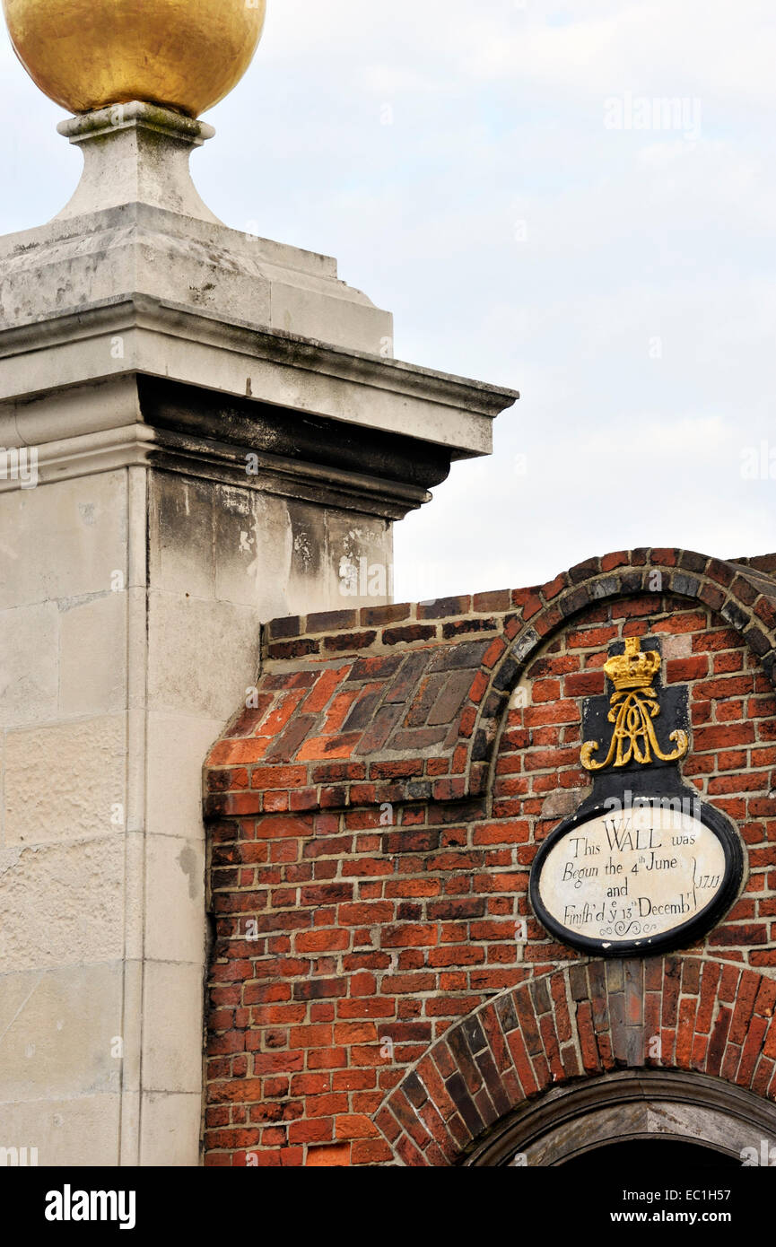 plaque, royal coat of arms and gold ball, dating from 1711, on the gates of Portsmouth Historic Dockyard, where - Stock Image