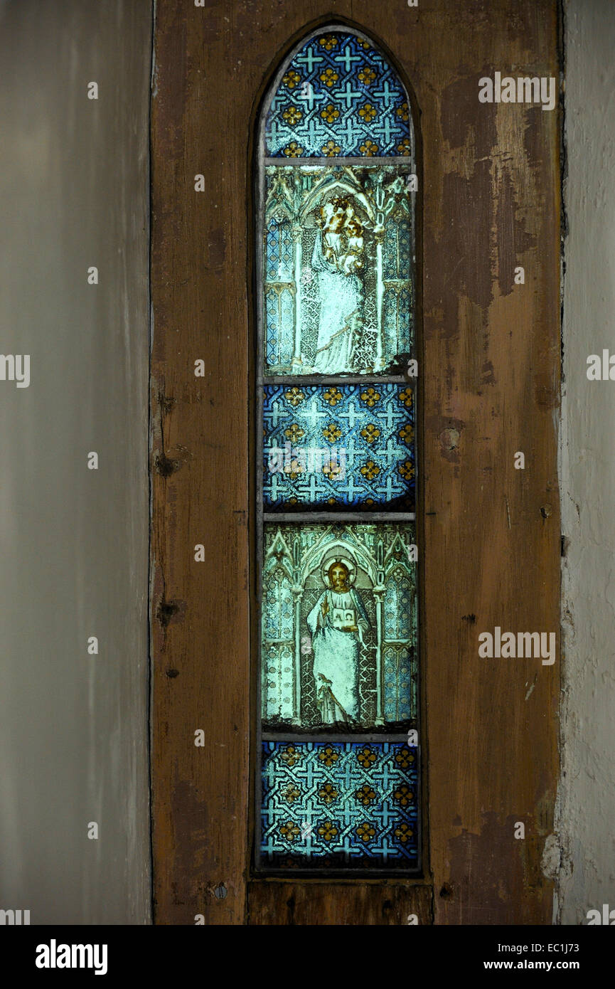 Medieval stained glass from 1500, Saint Michael's, Stinsford, outside Dorchester, Dorset.  A tiny window in - Stock Image