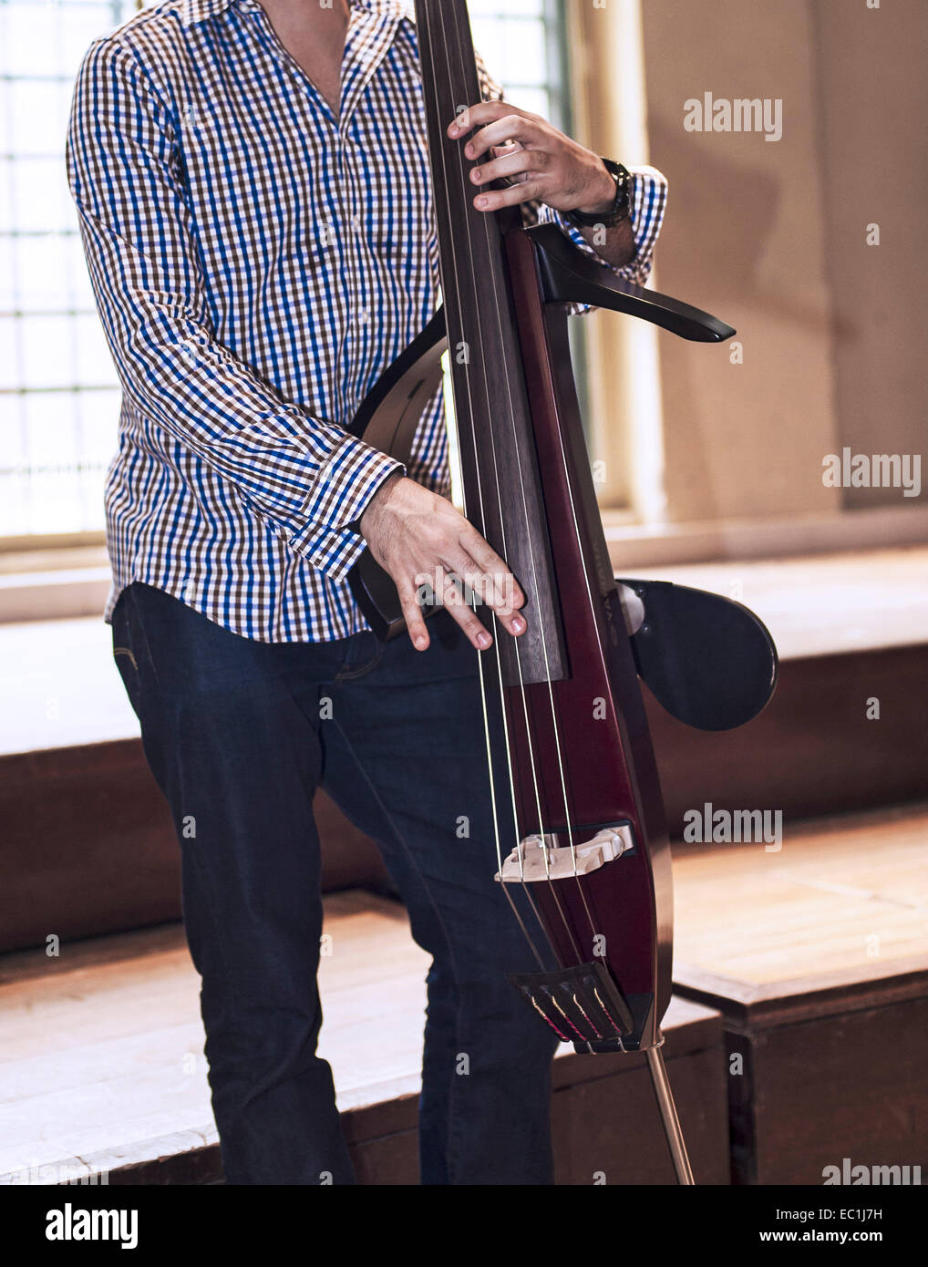 Silent electric upright bass,  double bass, 4-string, being played pizzicato Stock Photo