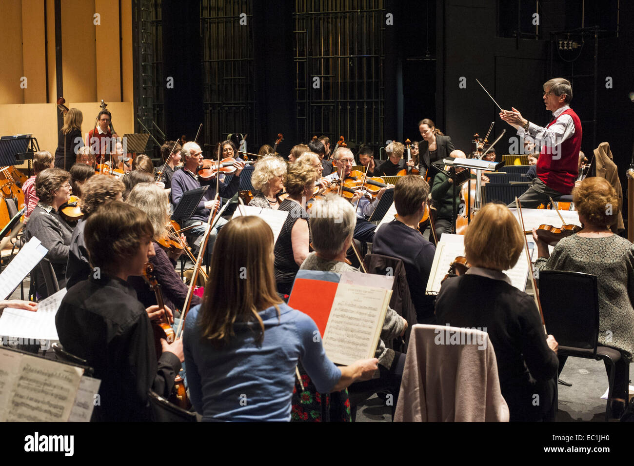 Youth and professional orchestra; Bedfordhire Youth Orchestra players join in a concert and (here) rehearsal with - Stock Image