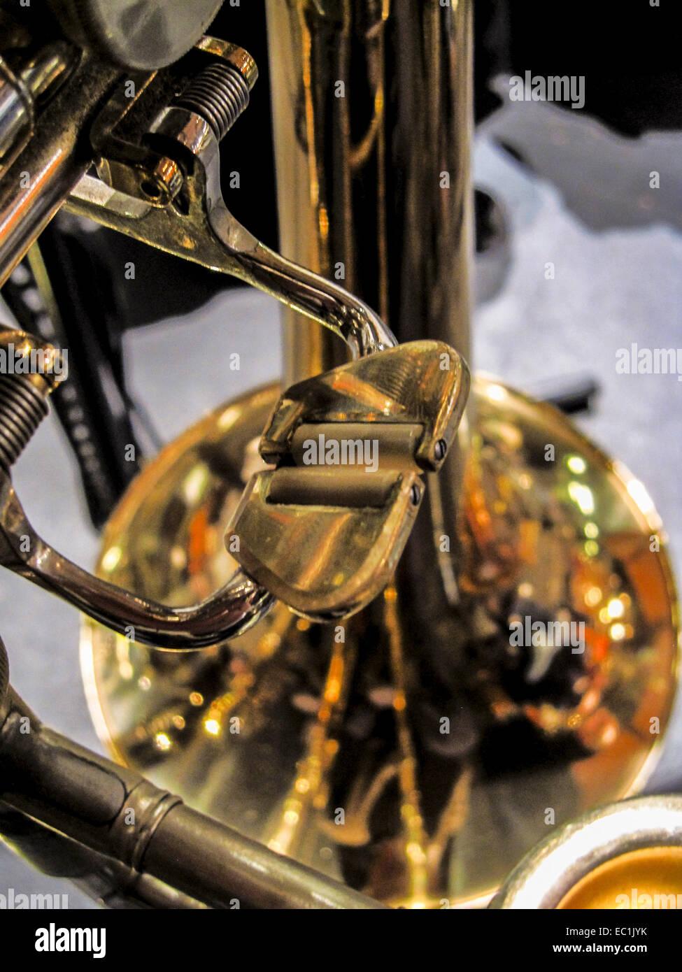 Trombone thumb trigger on rotary valve. Orchestral tenor trombone in Bb. A tenor trombone has either no valves or - Stock Image