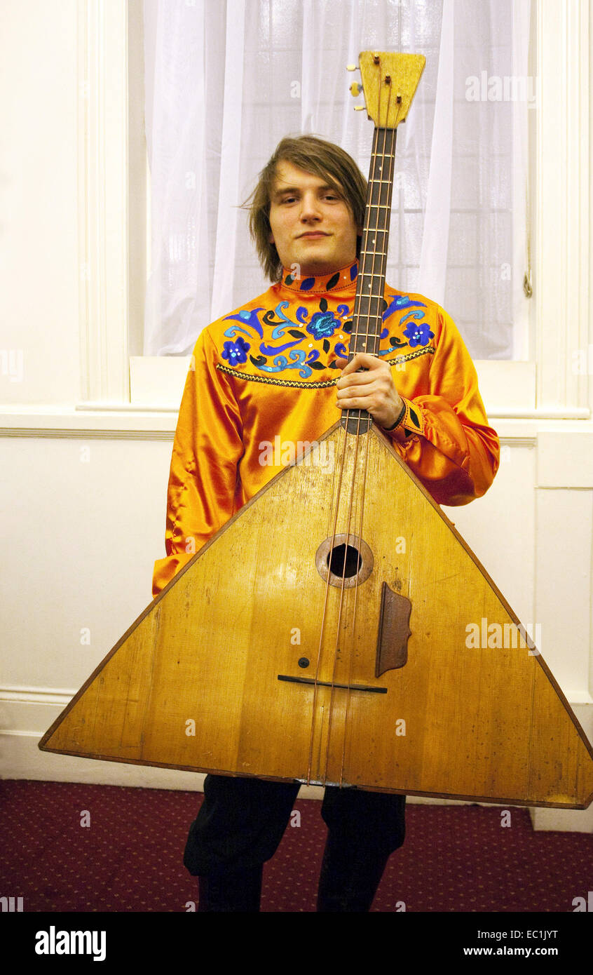 Contrabass balalaika. The balalaika  is a Russian folk stringed musical instrument with a characteristic triangular - Stock Image