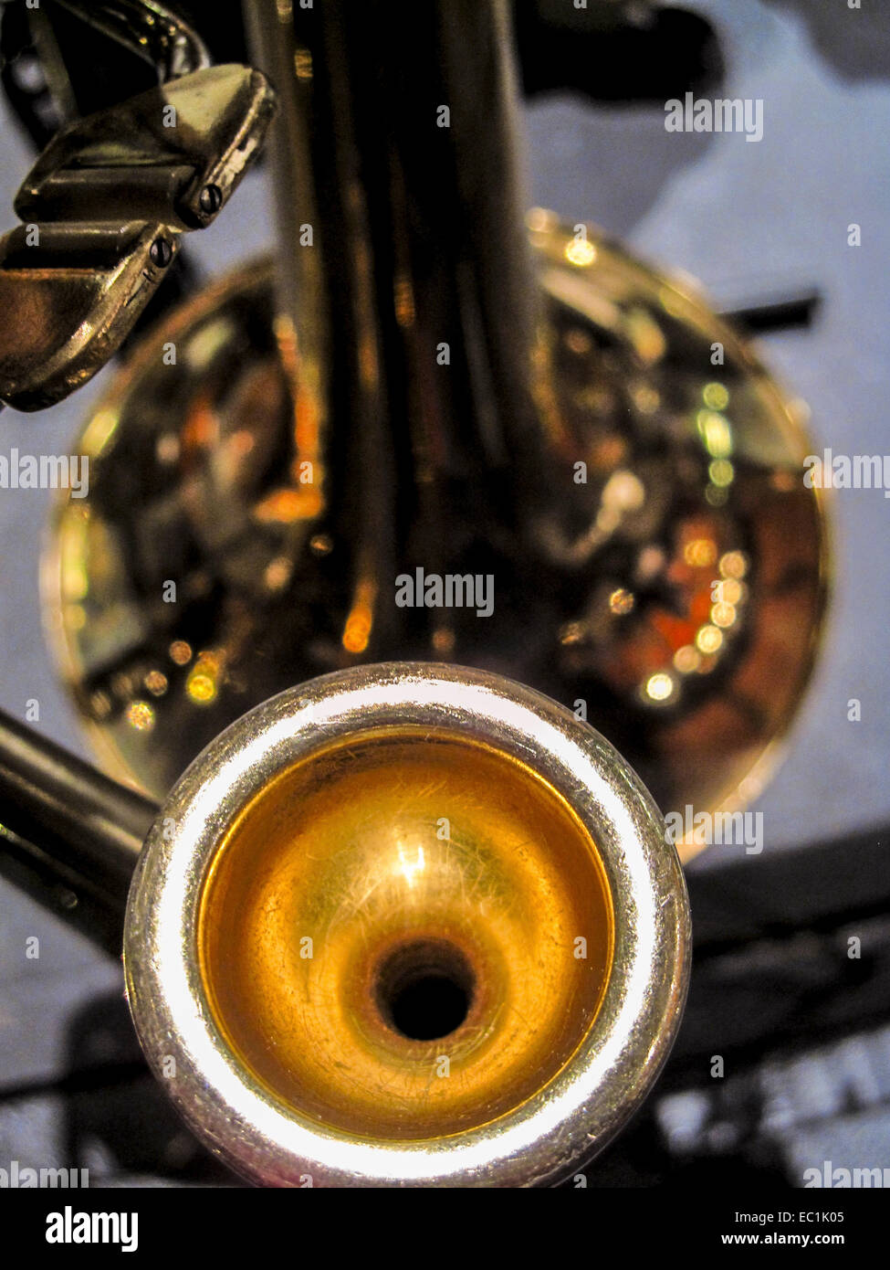 Mouthpiece, tenor trombone in Bb, with thumb trigger controlling rotary valve. This trigger drops the tuning down - Stock Image
