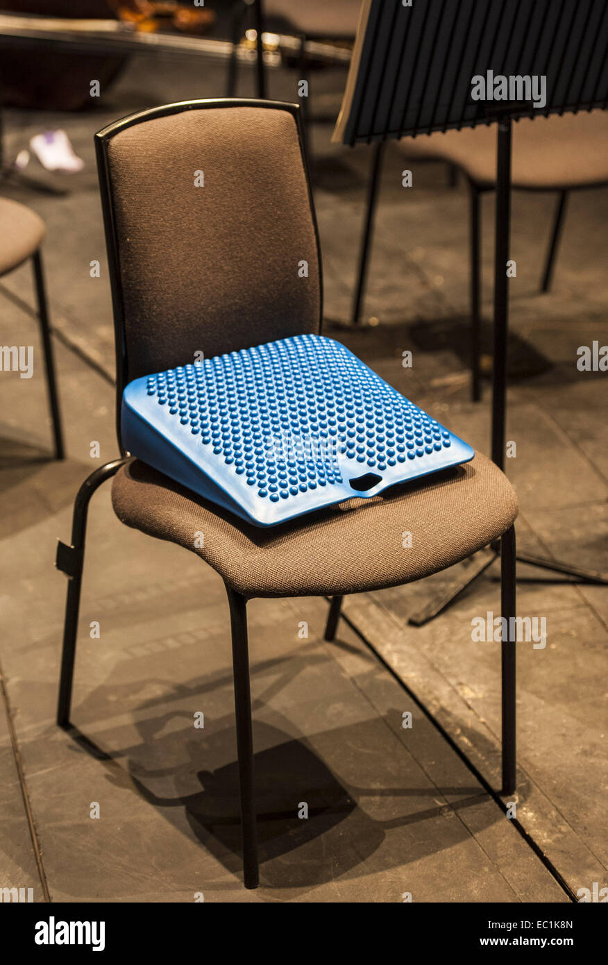 CellistÕs seat support cushion, sloping and designed in rubber to support the back from the unsuitable chairs - Stock Image