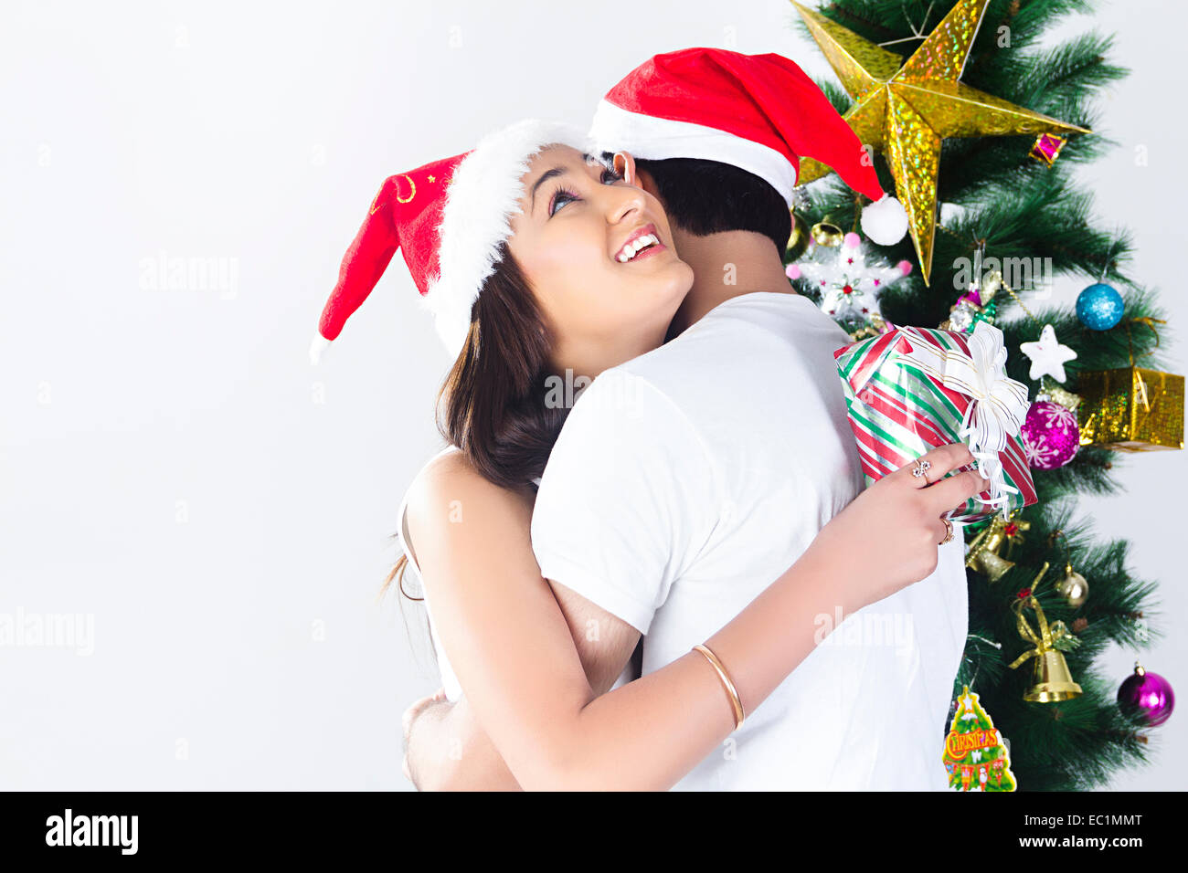 indian couple Christmas Festival Surprise gift Stock Photo: 76255560 ...