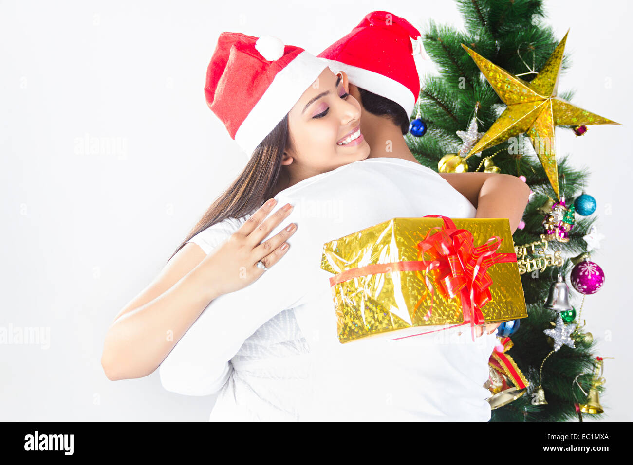 indian couple Christmas Festival Surprise gift Stock Photo: 76255714 ...
