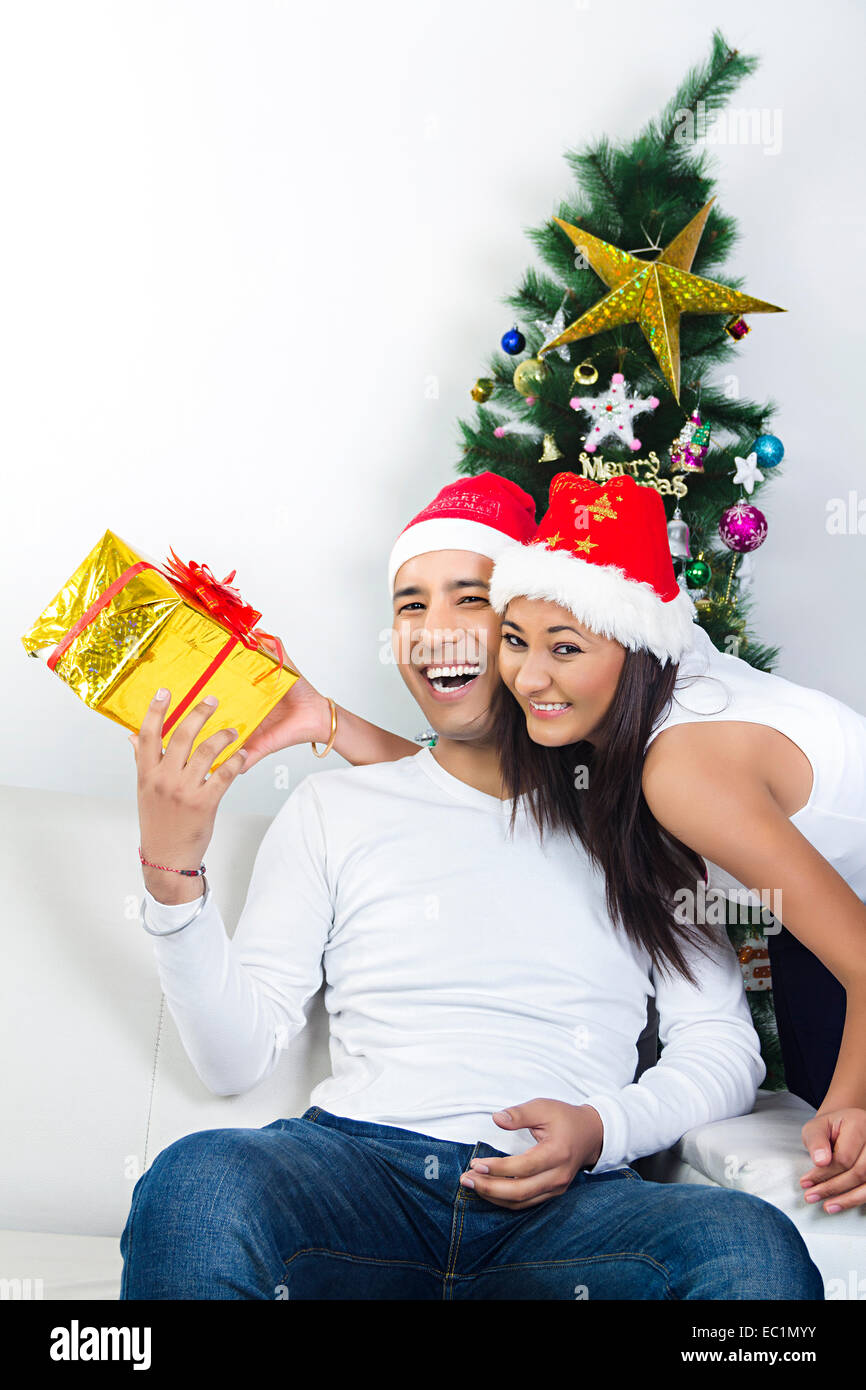 indian couple Christmas Festival surprise gift Stock Photo: 76255759 ...
