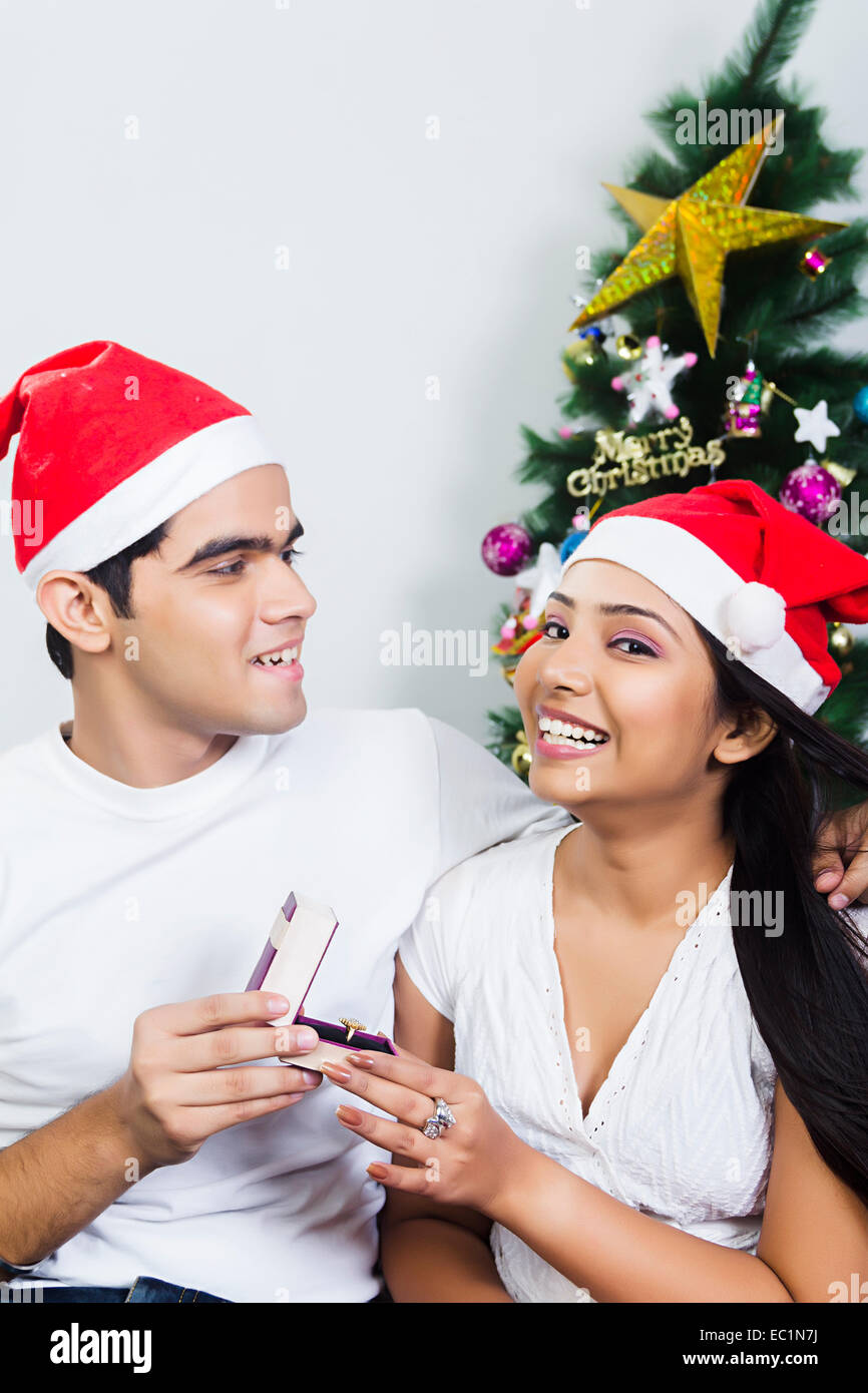 indian couple Christmas Festival surprise gift Stock Photo: 76255974 ...