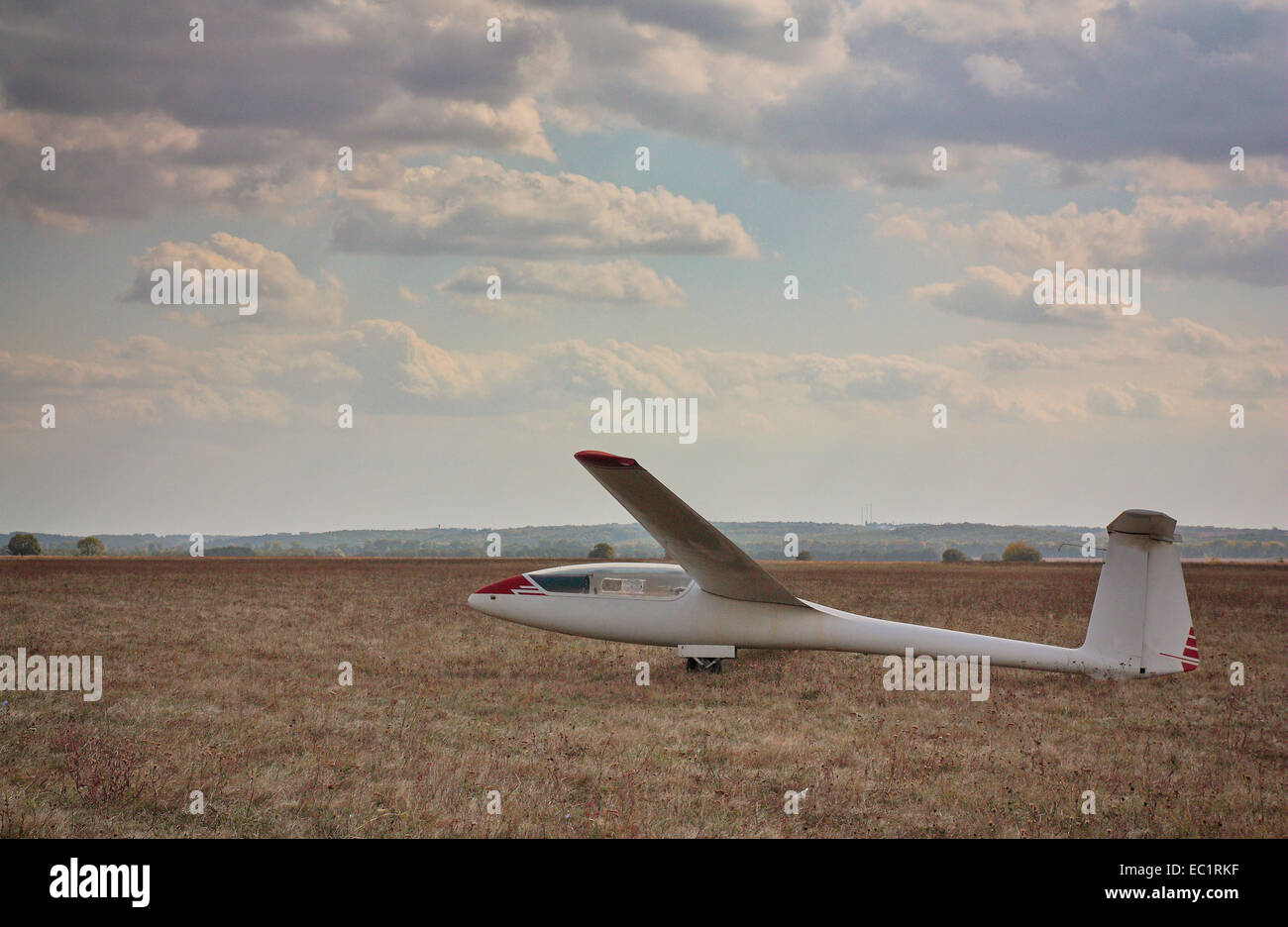 The old glider against the cloudy sky - Stock Image