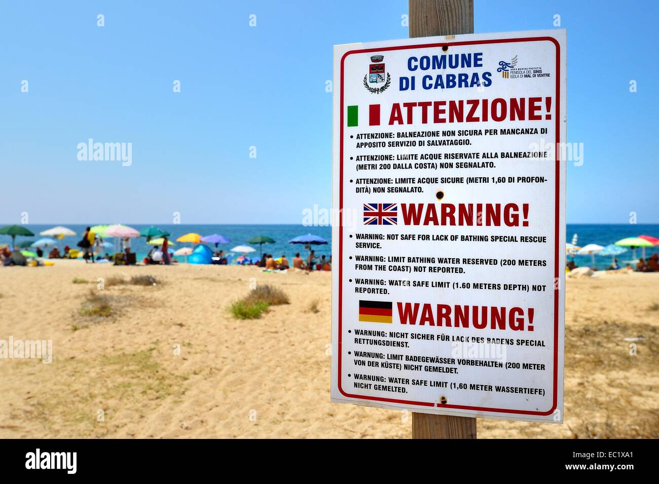 Funny German translation on a warning sign on the beach, Sinis peninsula, Sardinia, Italy, Europe - Stock Image