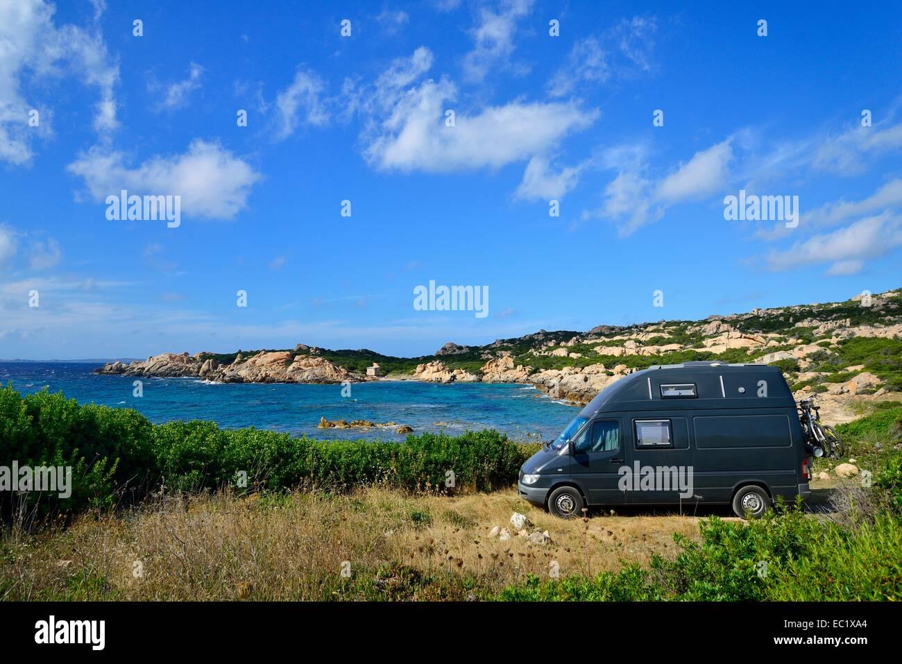 Camper on a bay, Caprera, Isola Maddalena, National Park La Maddalena archipelago, Sardinia, Italy - Stock Image