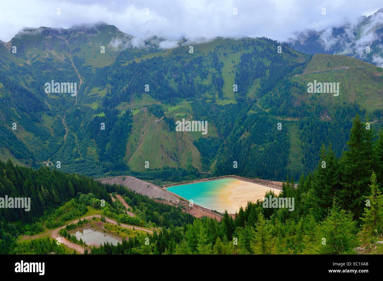 Sedimentation pool, sludge pond in the mining area of ​​the open pit mine, Erzberg mountain at Eisenerz, Styria, - Stock Image