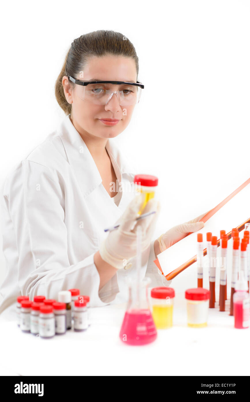 Young Woman working with biological material in a lab - Stock Image
