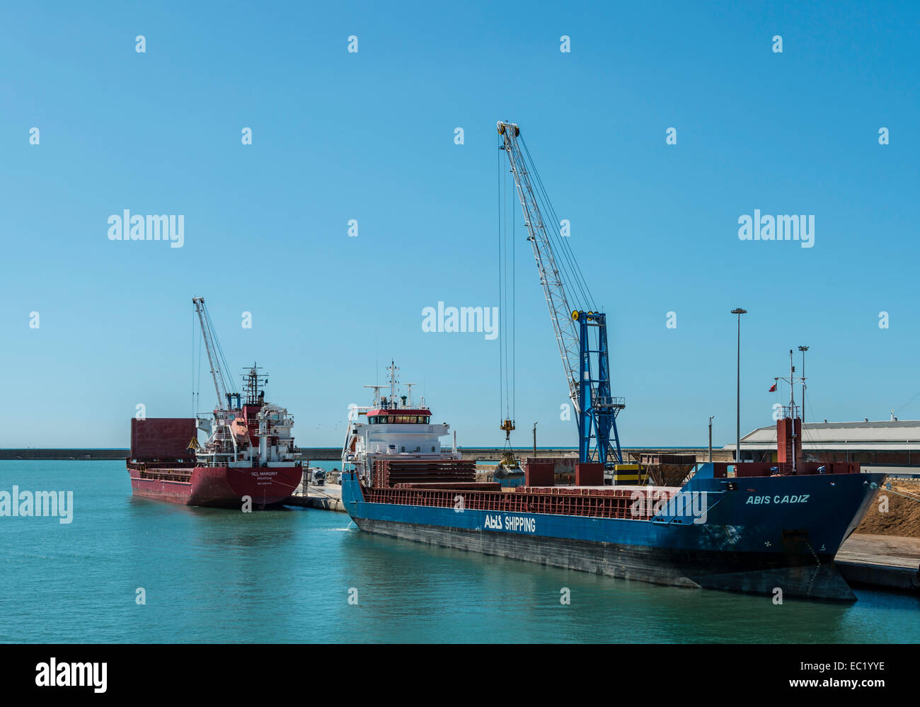 Ship being loaded with coal, cargo port of Livorno, Tuscany, Italy Stock Photo
