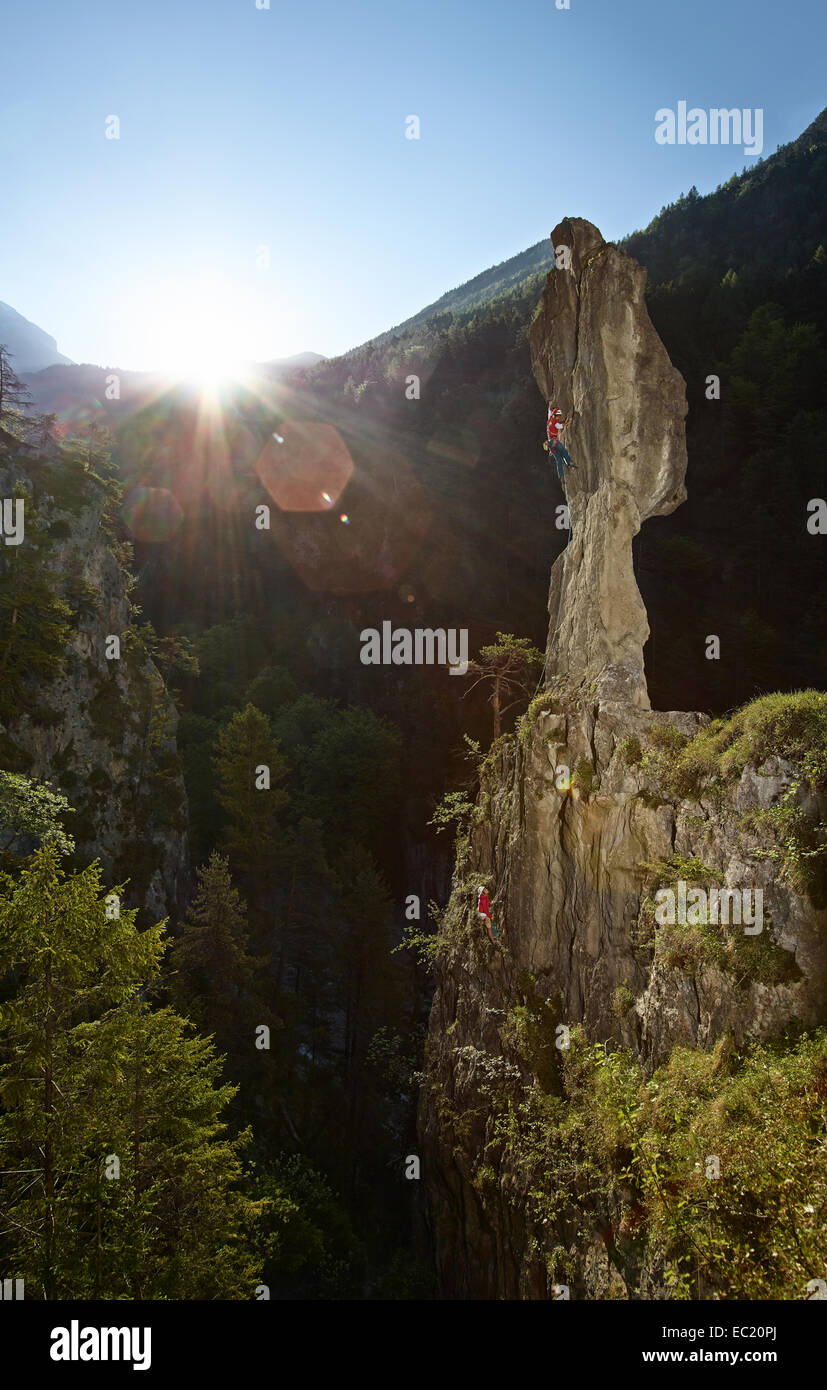 Sport climbers climbing a pinnacle, Ehnbachklamm gorge, Zirl, Tyrol, Austria - Stock Image