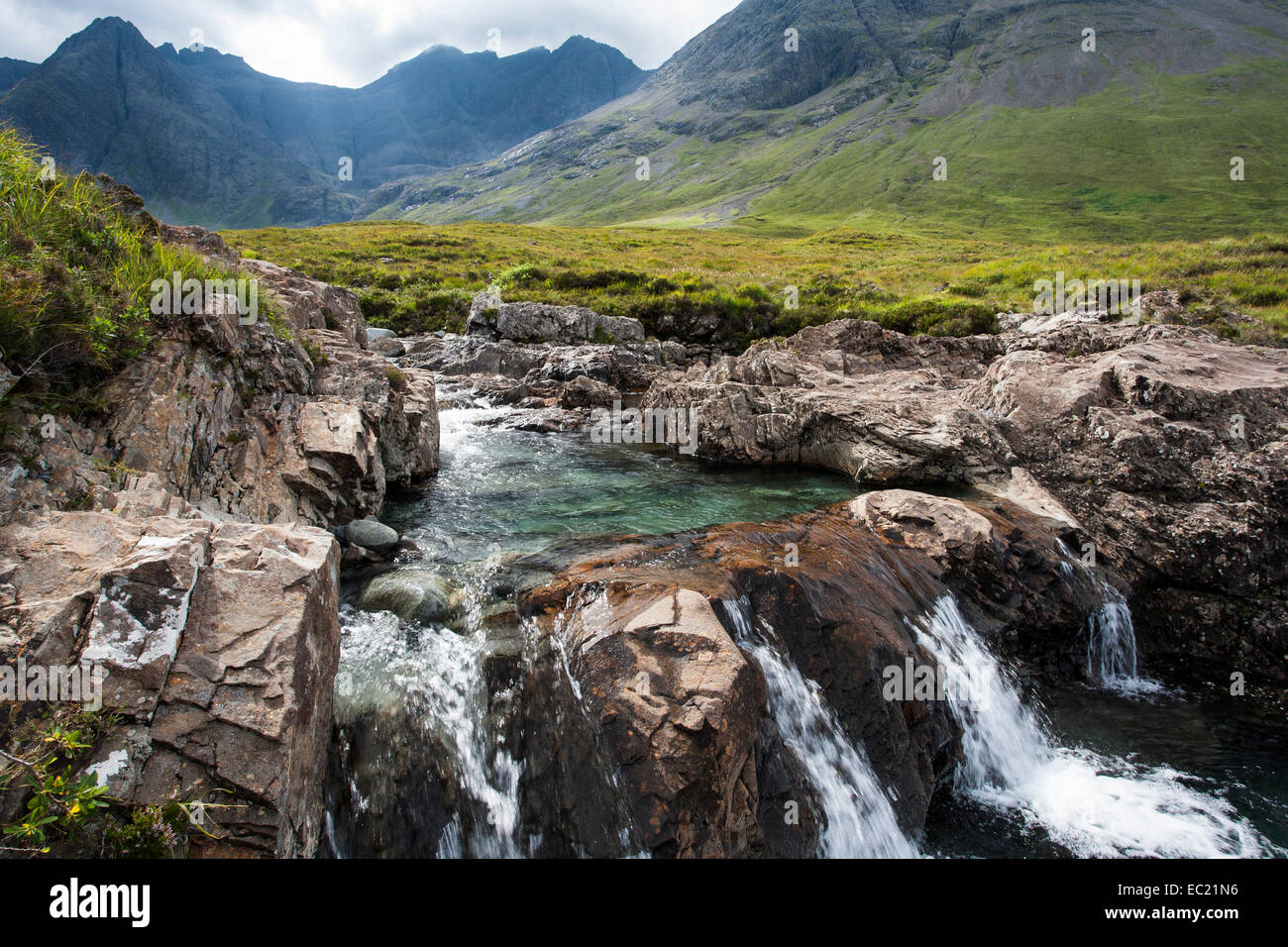 The Fairy Pools in Glen Brittle with Cuillin Hills behind, Isle of Skye, Scotland, United Kingdom - Stock Image