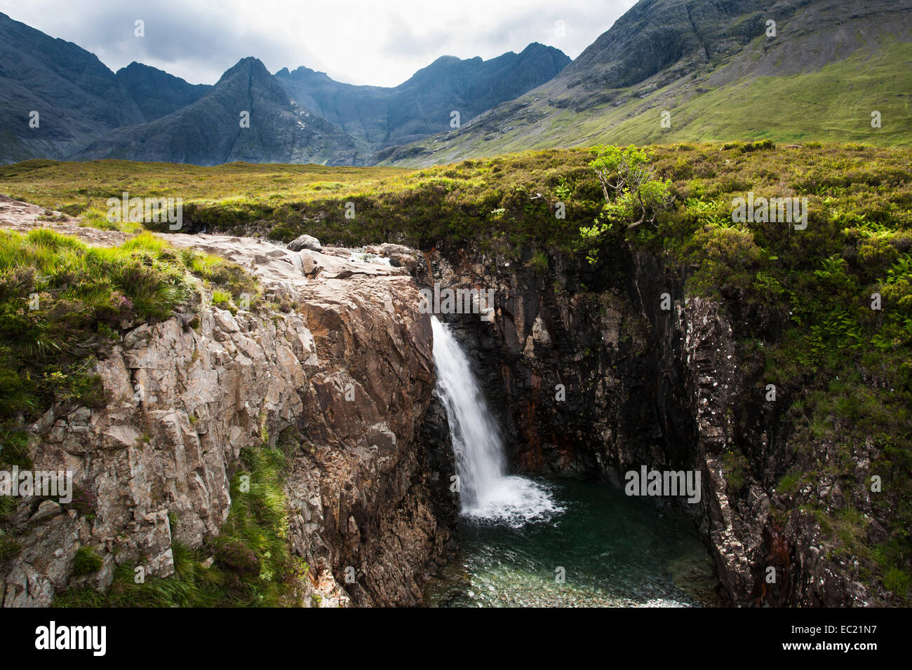 Waterfall at the Fairy Pools in Glen Brittle with Cuillin Hills behind, Isle of Skye, Scotland, United Kingdom - Stock Image