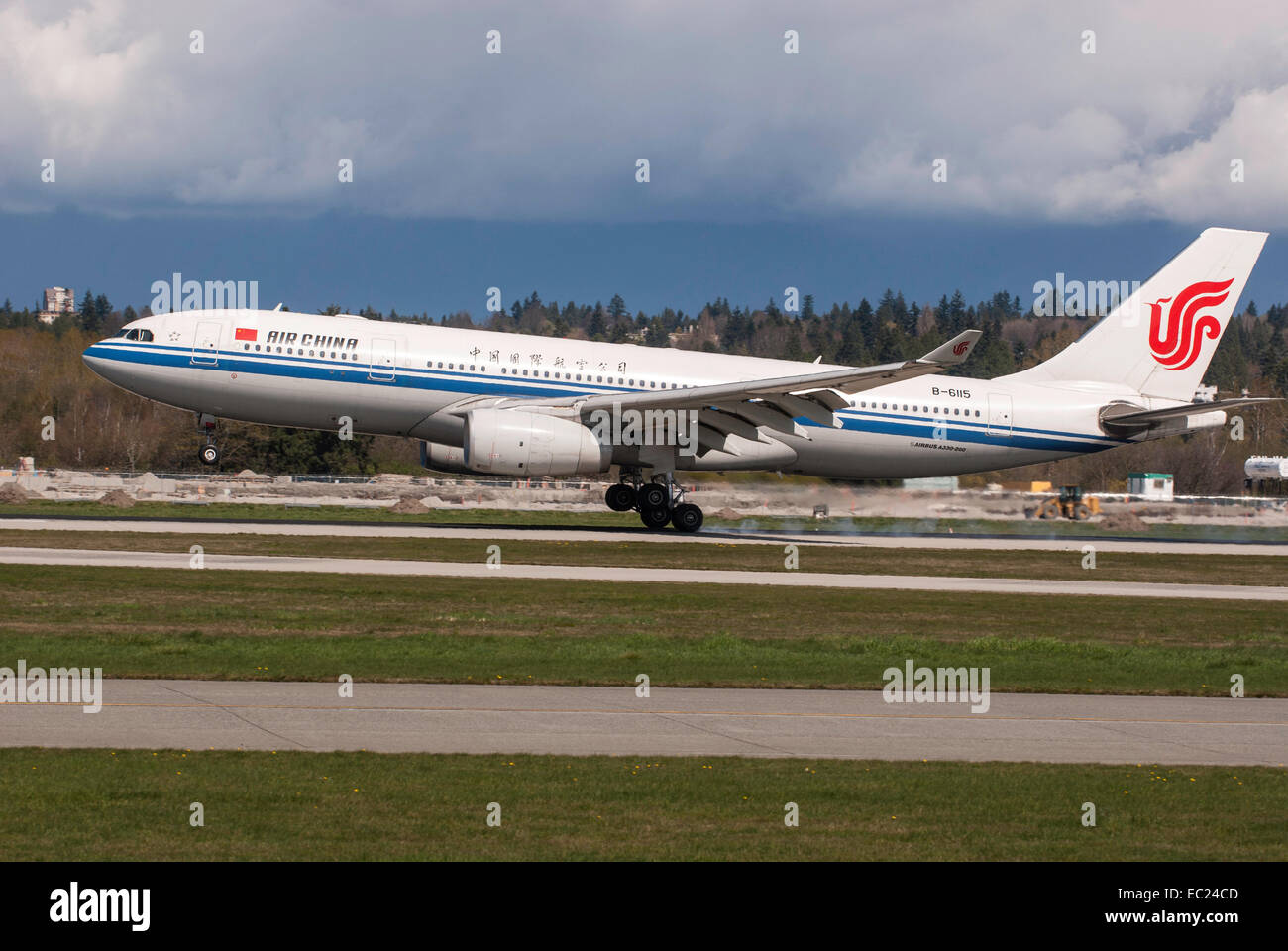 Air China commercial airliner Airbus A330-243 landing at YVR Vancouver International Airport. - Stock Image