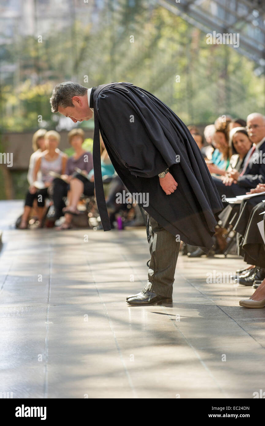 Future lawyer bowing showing respect to the court in a Call to Bar Ceremony in the Great Hall at the Vancouver Law - Stock Image