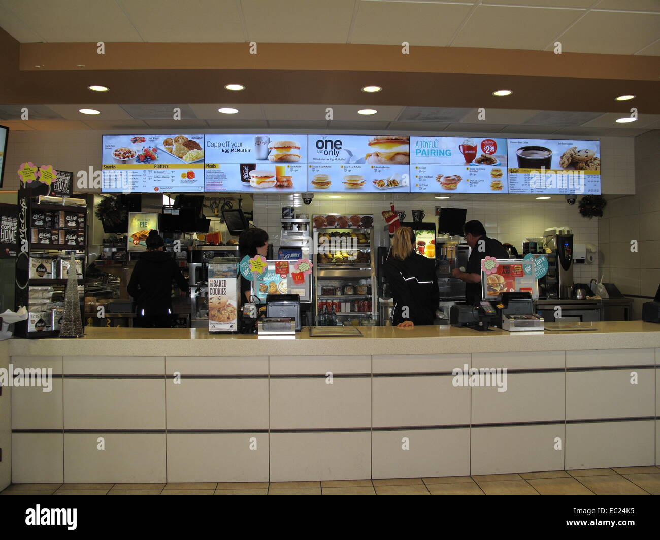 The interior order counter at a McDonald's Restaurant showing the breakfast menu - Stock Image