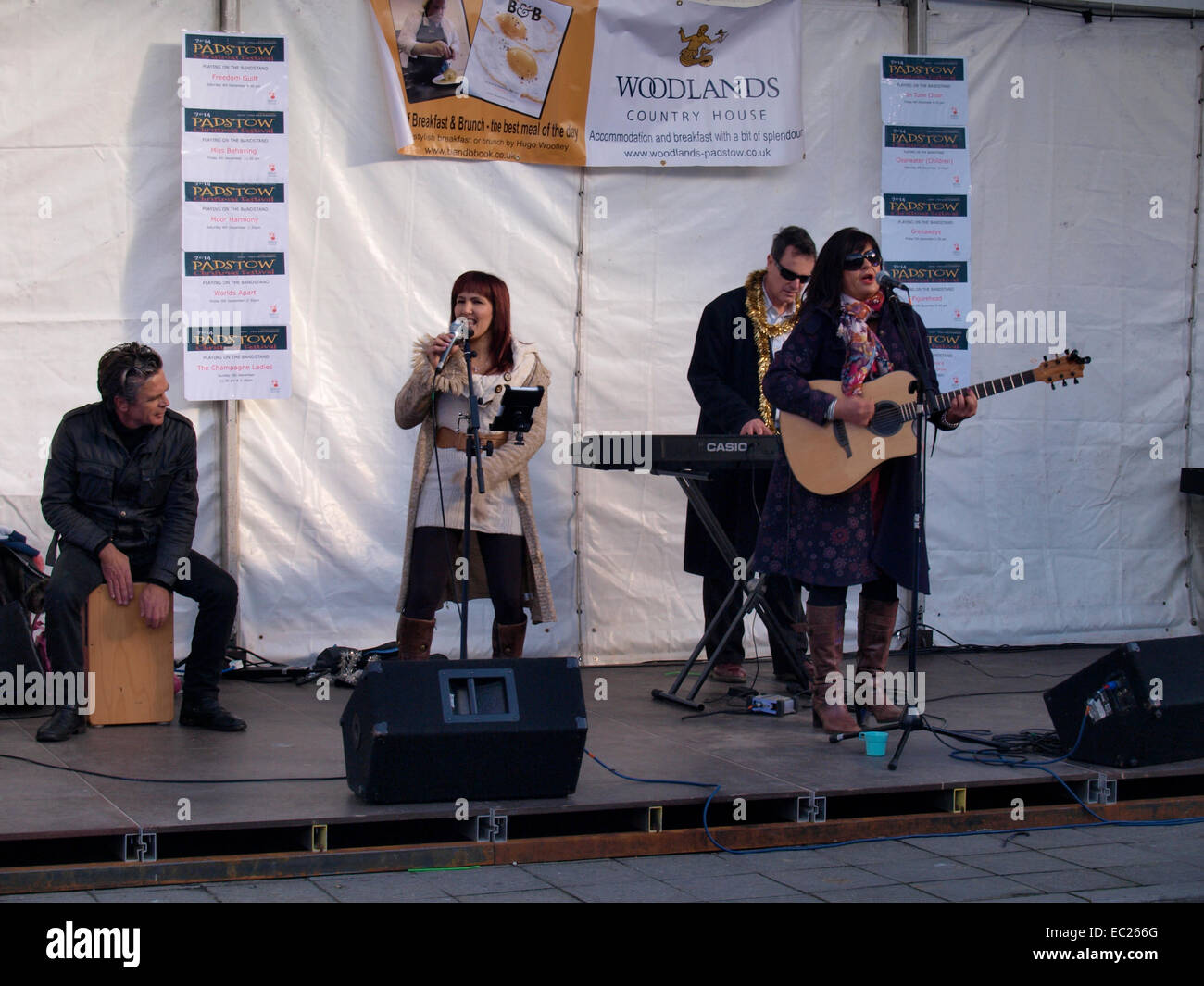 Musical group, Little Loving on stage at the Padstow Christmas festival, Cornwall, UK - Stock Image