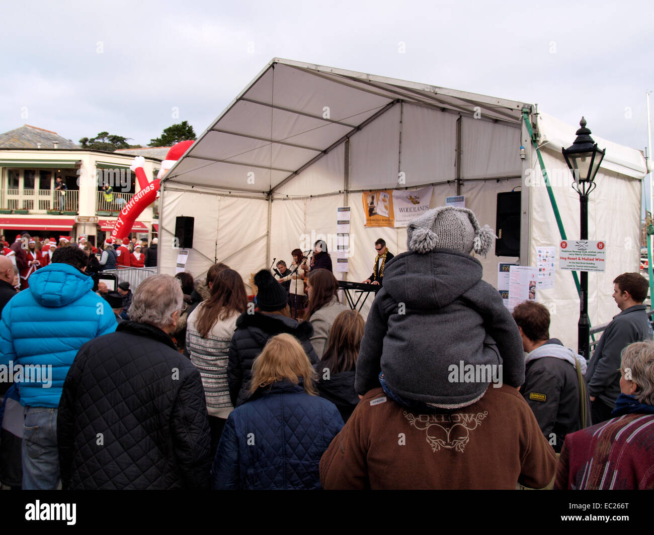 Crowd listening to the musical group, Little Loving at the Padstow Christmas festival, Cornwall, UK - Stock Image