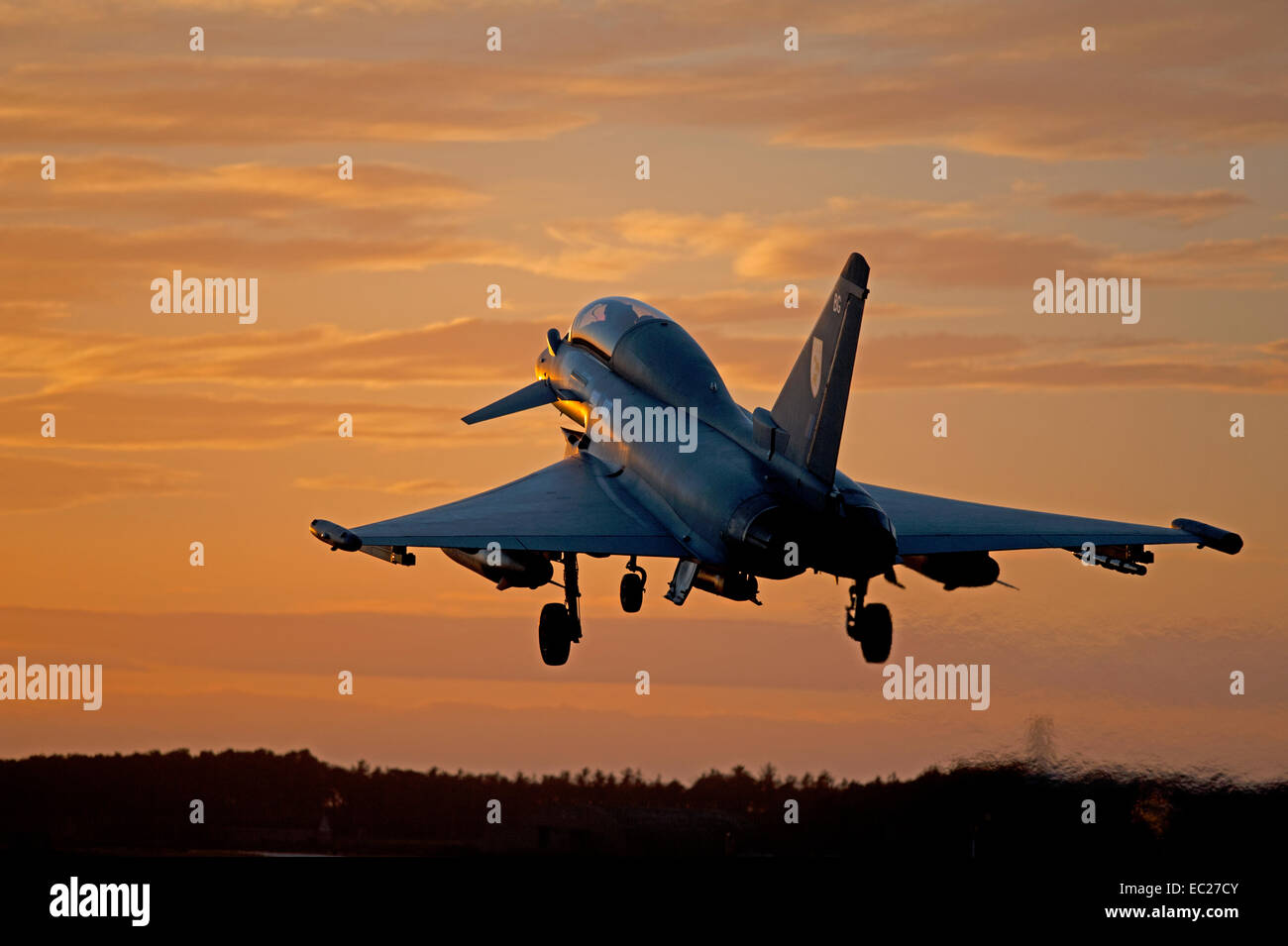 Eurofighter Typhoon returning to base at sundown after an afternoon mission.  SCO 9299. - Stock Image