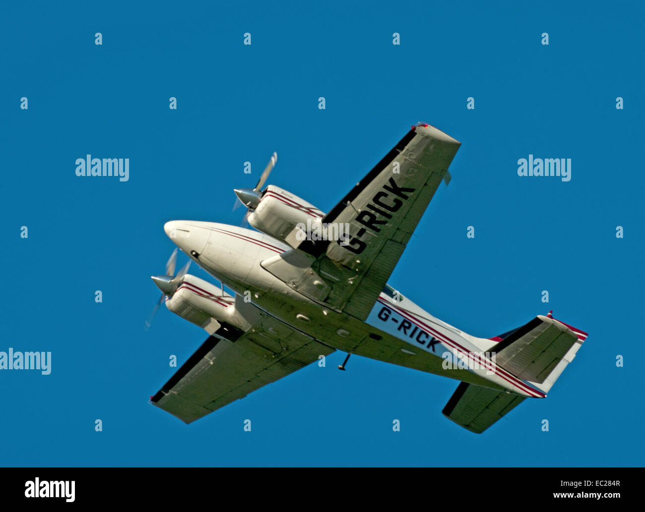 Twin Engined Propellor driven Cessna 421C Golden Eagle light aircraft over Inverness. SCO 9272. - Stock Image