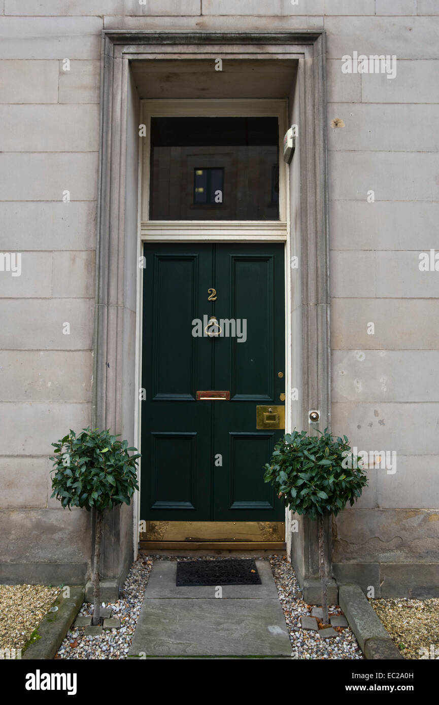 Green No 2 front door with shrubs outside period house in city centre Edinburgh Scotland UK Stock Photo