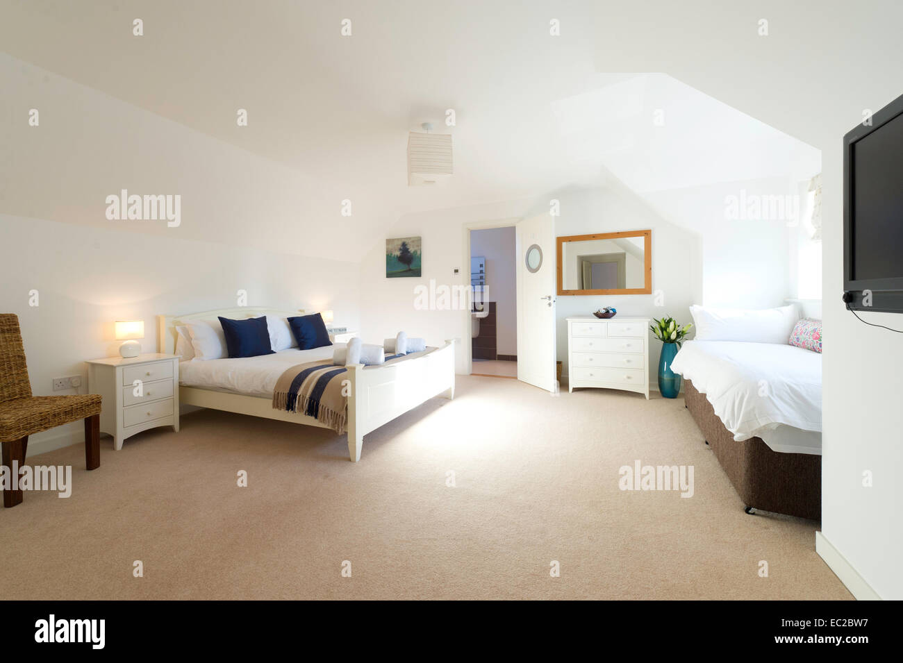 A holiday home bedroom - Stock Image